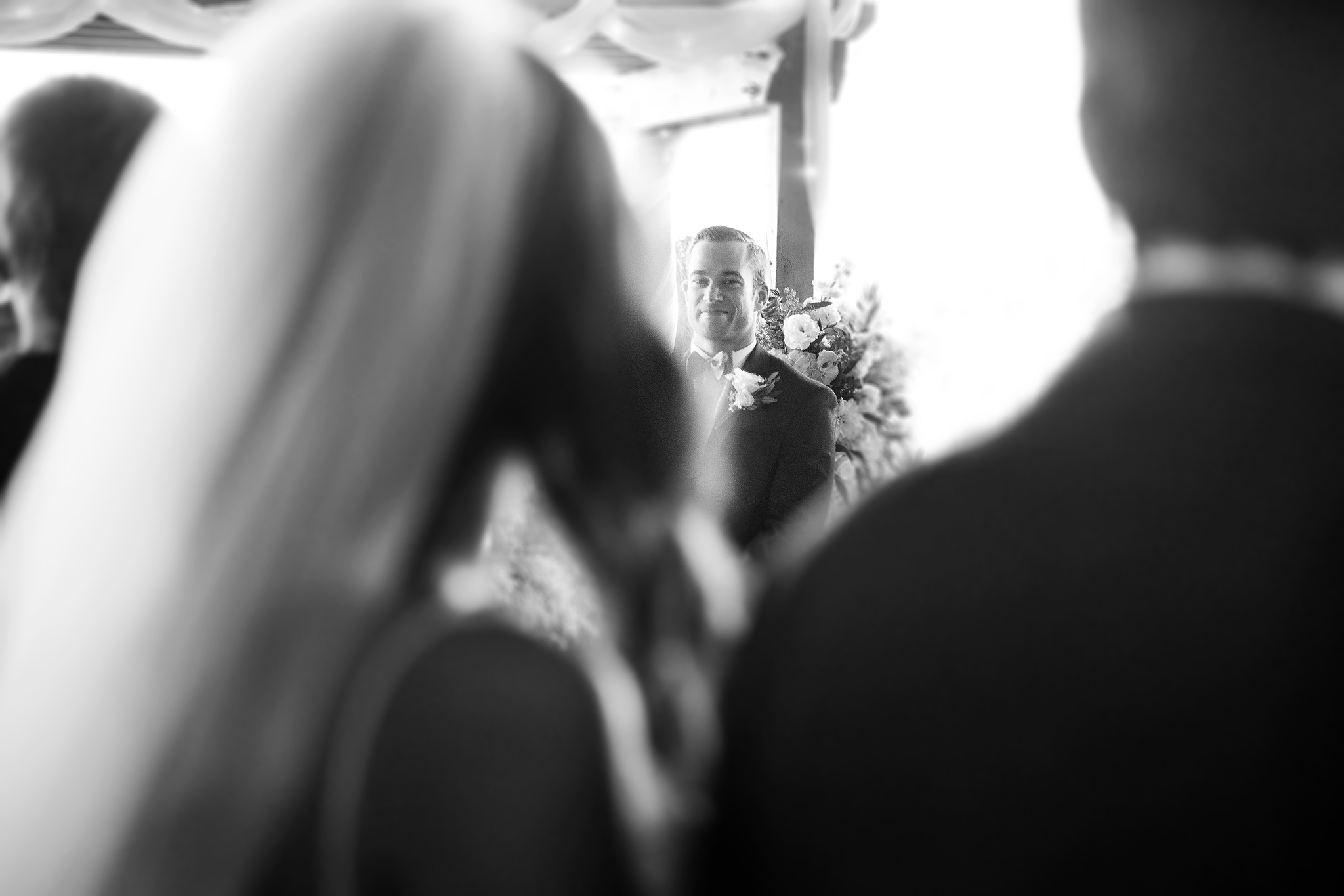 wedding ceremony black and white groom first look