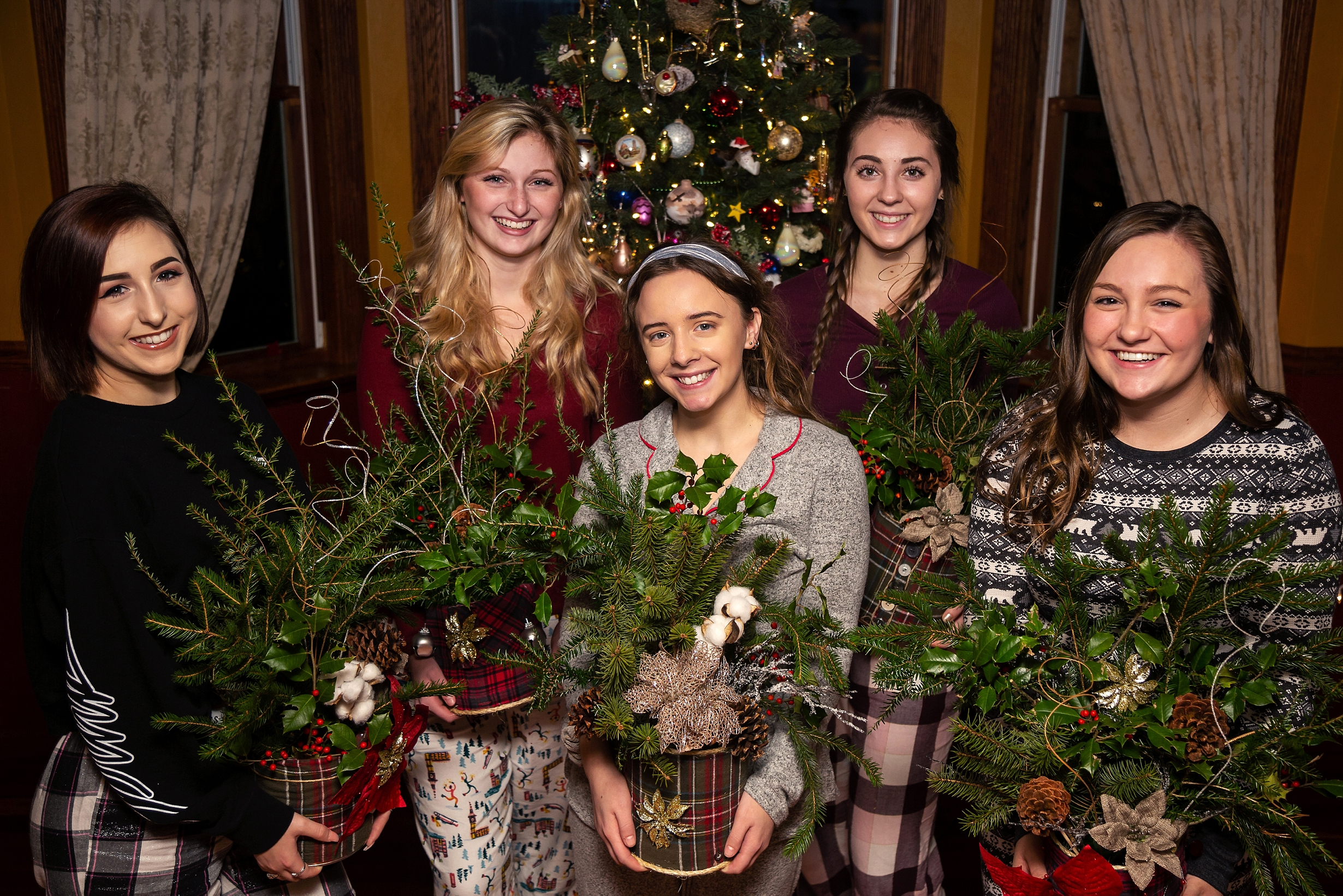 2019 VIP Representatives create christmas evergreen centerpieces to donate to a local nursing home (Saint Andrew's village, Indiana PA). Jessica Miladinovich, Lauren Wilner, Marissa Tunstall, Maggie Arone, Blake Tonkin.
