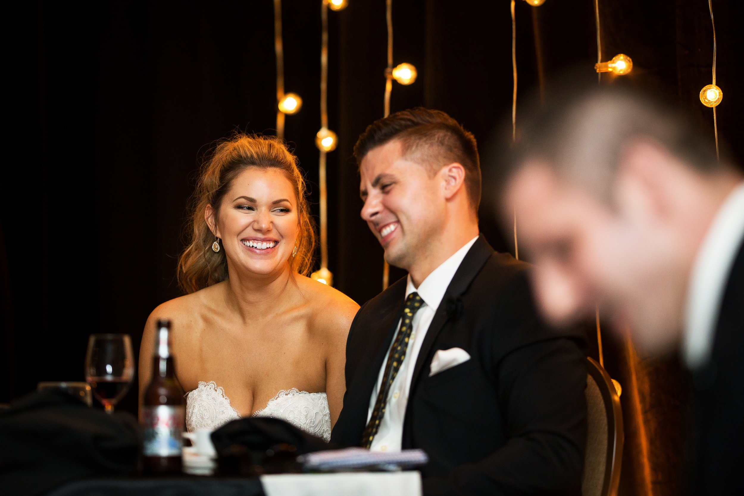 Bride and Groom Laughs at Toast