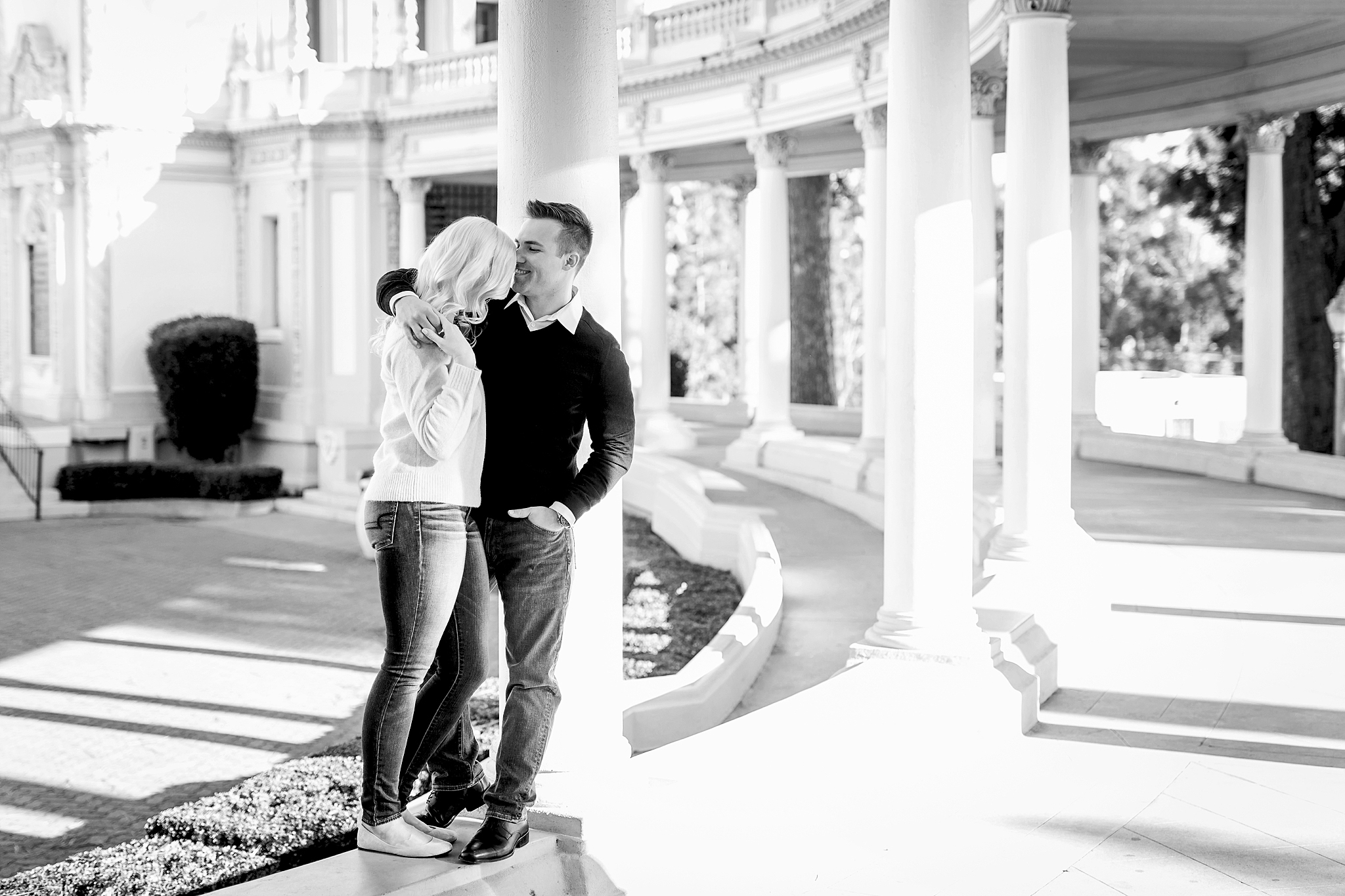 Cora and Zach take on Balboa park in San Diego for their engagement session. Here they are back lit by the golden hour sun at the Spreckels Organ Pavillion.