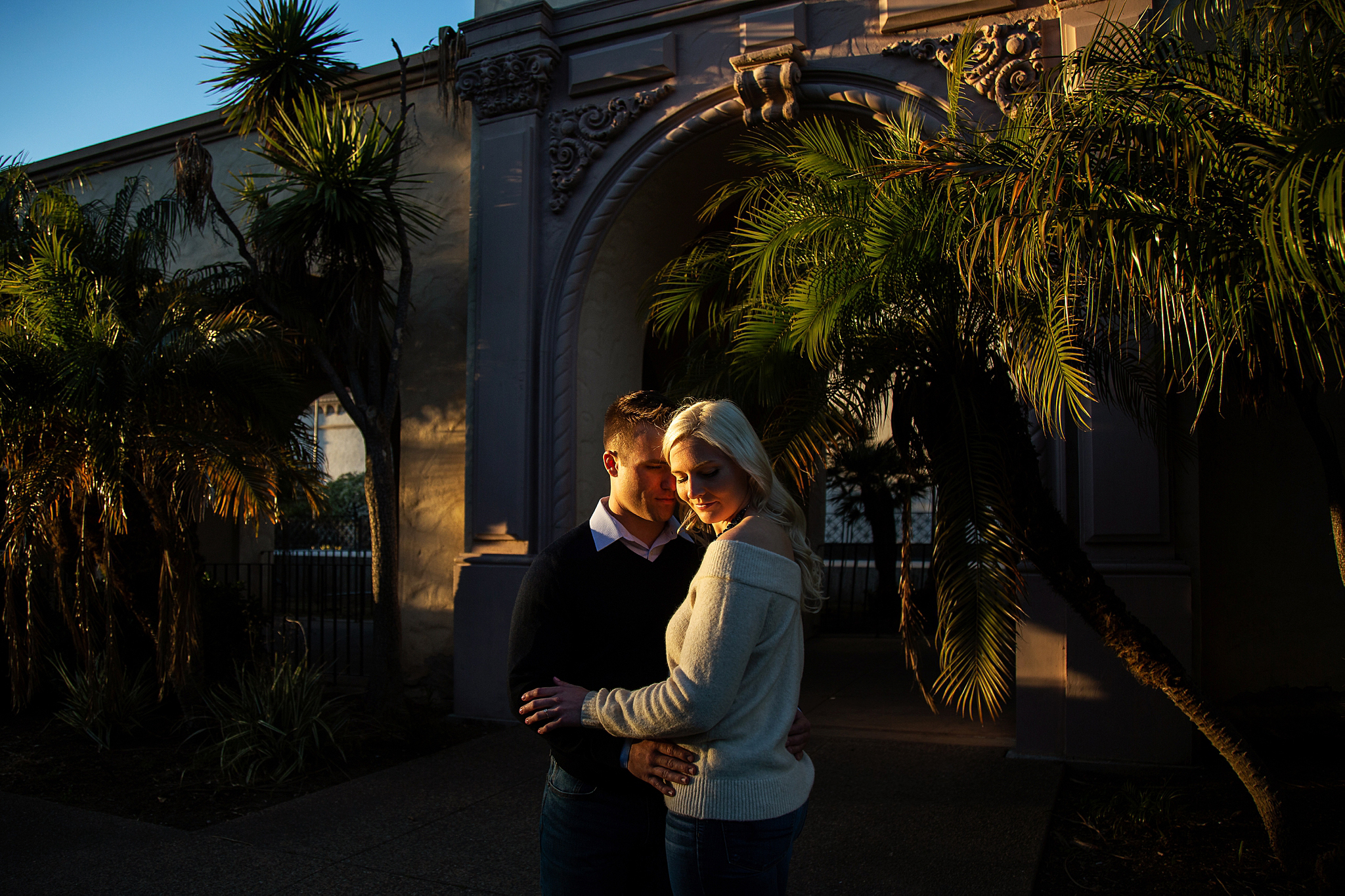 The California golden light perfectly illuminates the couple. Photographed at Balboa Park in San Diego