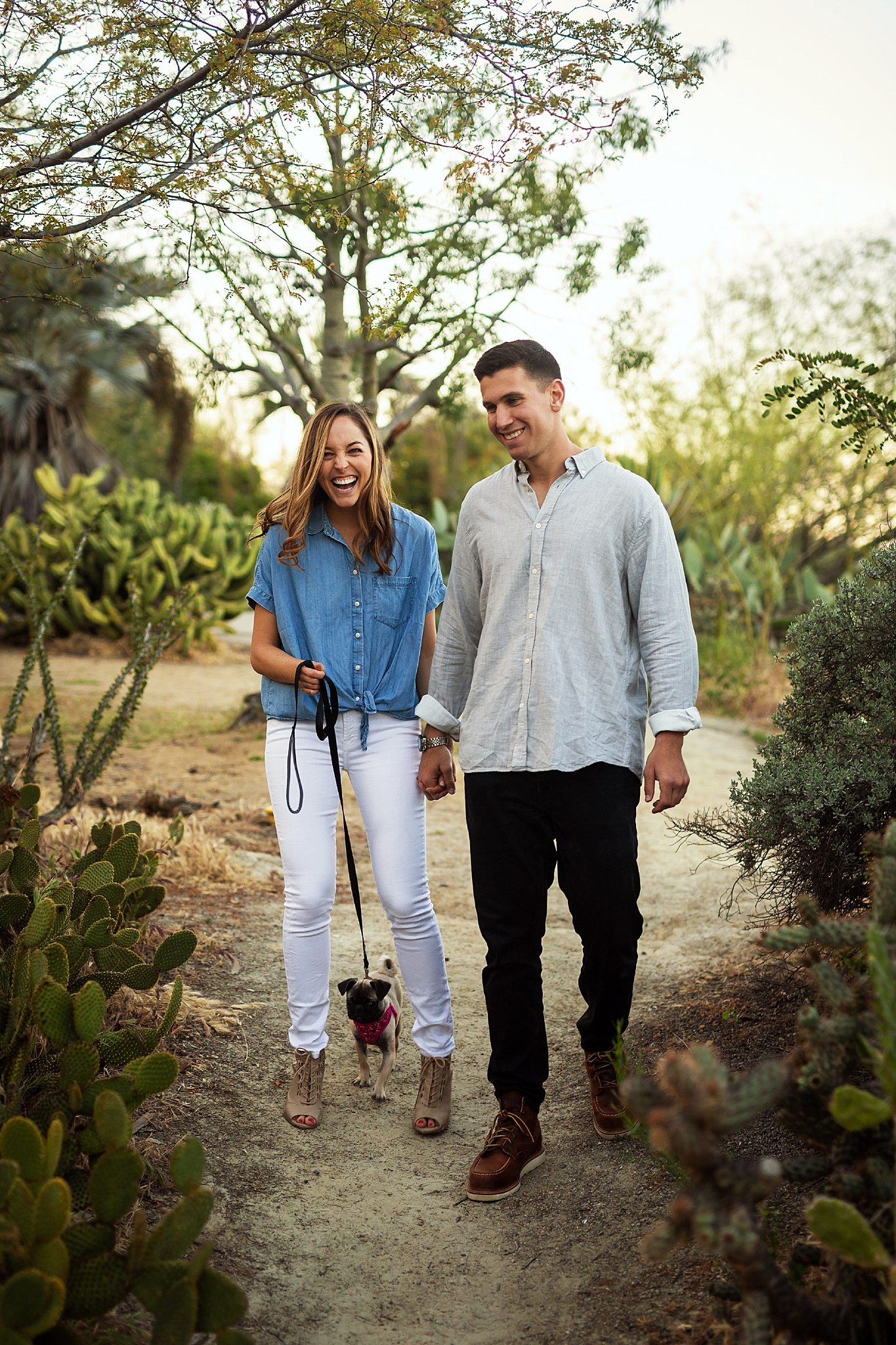 Golden hour engagement session at Balboa Park, San Diego, California with Meaghan and Eli. The couple walks their pug, Frankie, through the cactus garden.