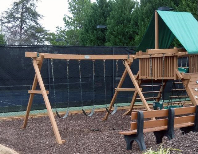 An example of Non-Public Use Equipment: note that the swingset structure is sagging.