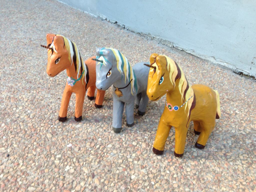 Unicorns made and handpainted by the artists above
