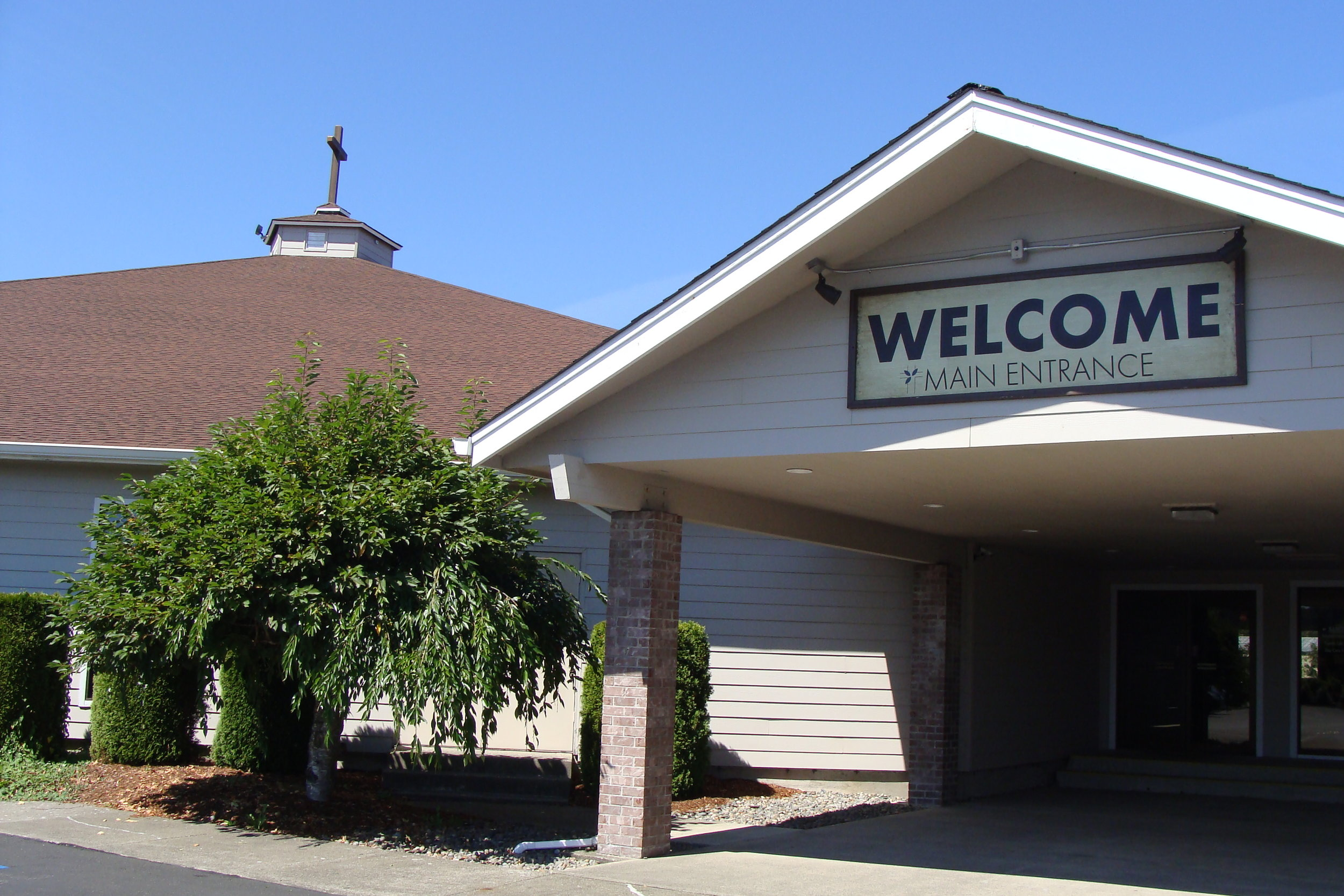 Approaching the building... - We have a small parking lot in the