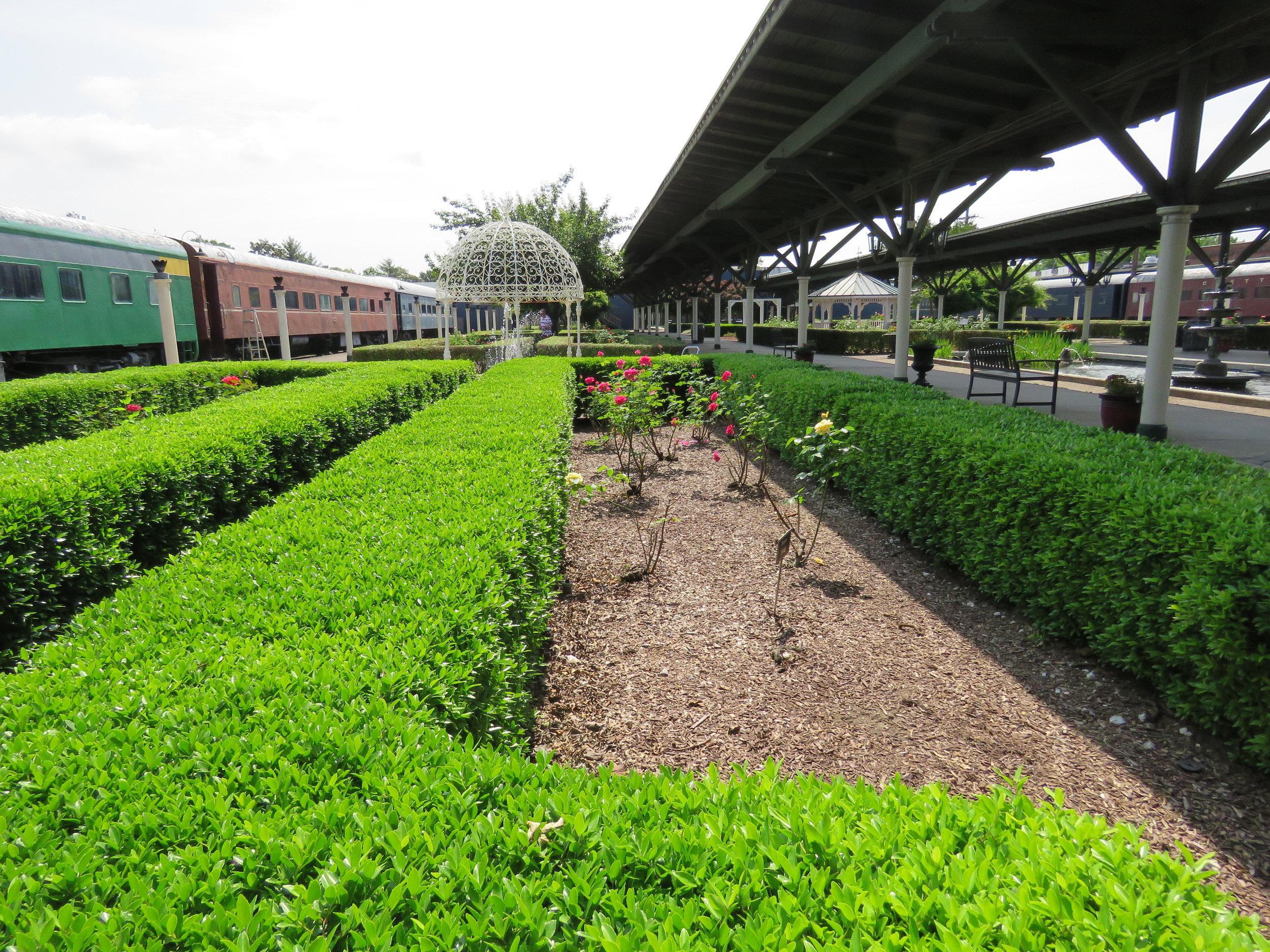 glenn miller gardens near the train cars
