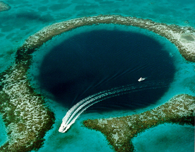 Aerial View of the Great Blue Hole off the coast of Belize. By U.S. Geological Survey (USGS) [Public domain], via Wikimedia Commons