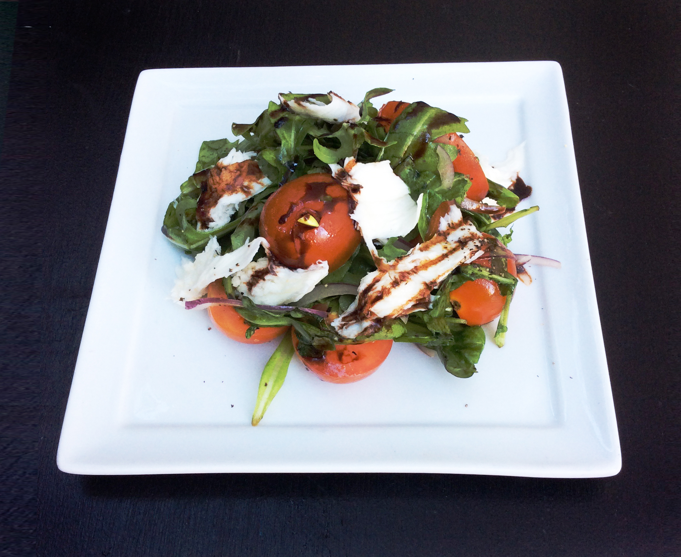 2nd Course - Caprice Salad - Caprice salad with fresh mozzarella, tomatoes, fresh basil, arugula, red onion, and a drizzle of balsamic reduction