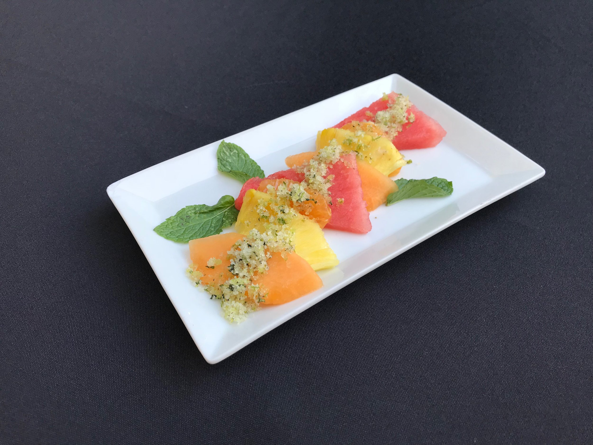 Melon Salad  - Sliced cantaloupe, watermelon, pineapple, and tangerine segments dusted with citrus sugar and fresh mint