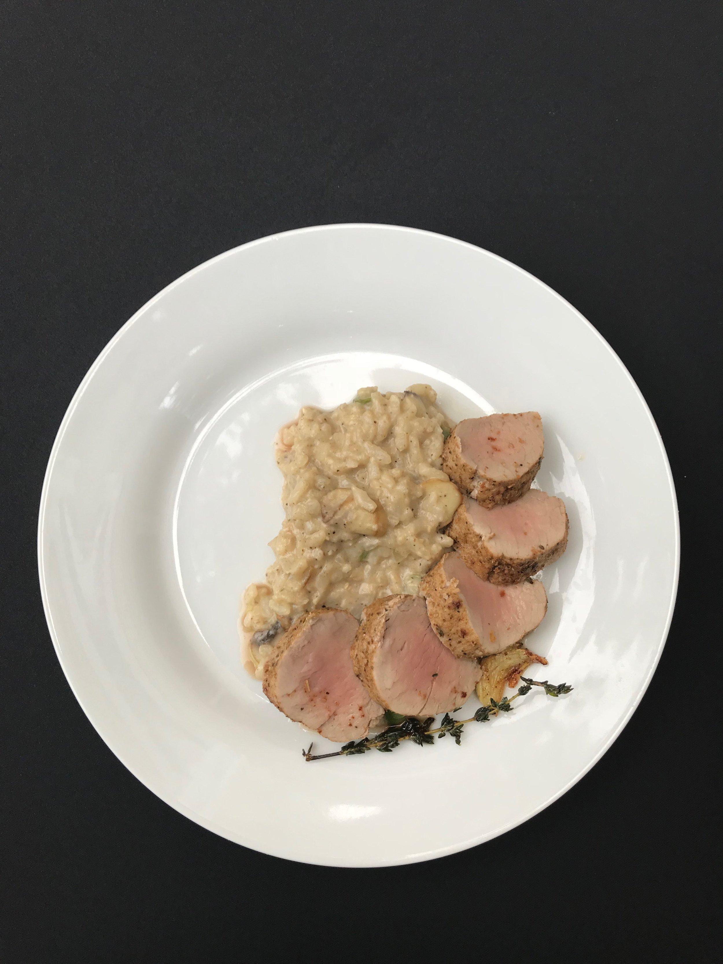 Pork Tenderloin  - Pork tenderloin, sautéed with coriander, oregano and thyme accompanied by chimichurri sauce over asparagus-mushroom risotto
