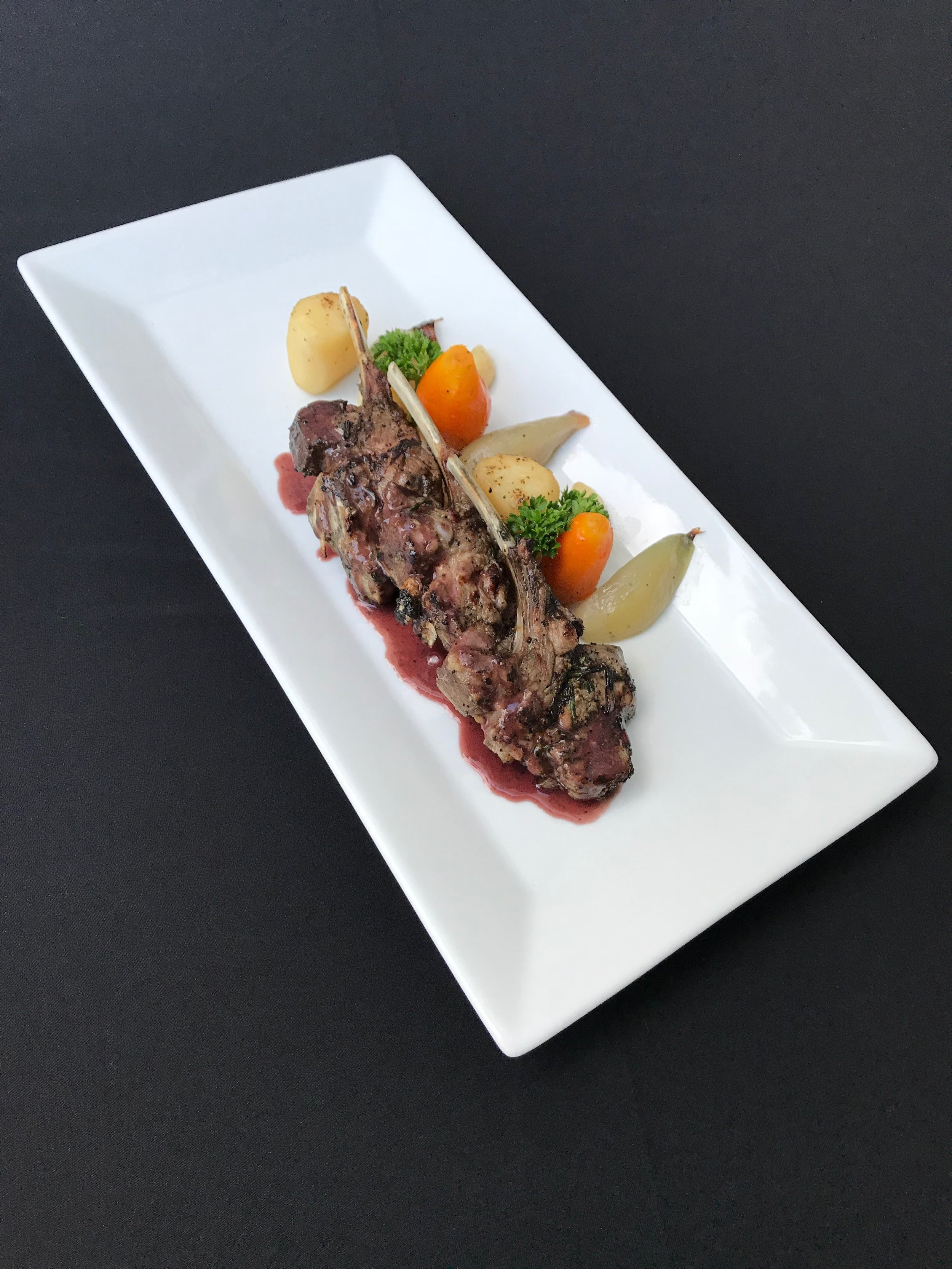 Lamb Chops - Grilled lamb rib-chops with roasted root vegetables and lamb au jus
