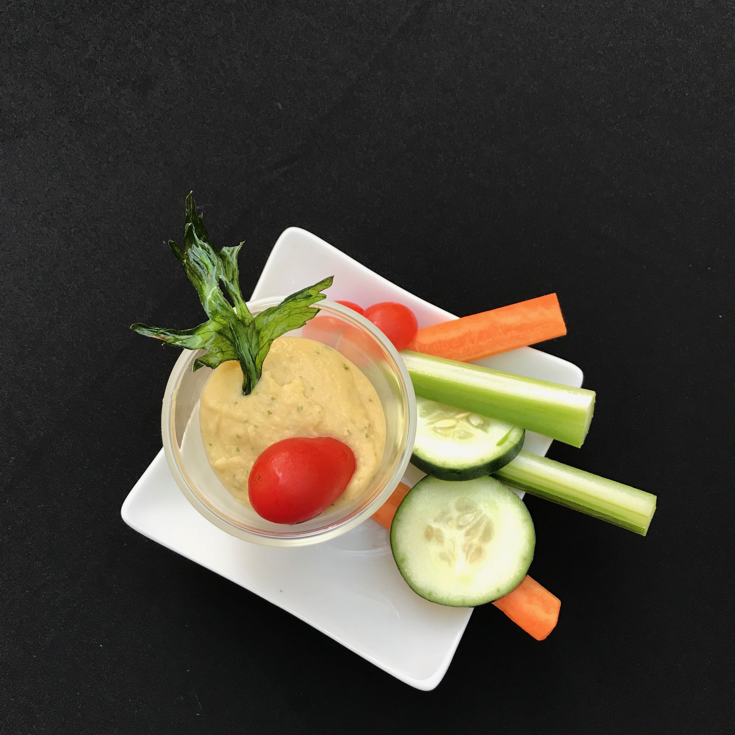 - Artichoke and Roasted Garlic & Lemon HummusCreamy pureed chickpeas and artichoke hearts, with roasted garlic, cumin, cayenne and tahini and served with celery, cucumber and carrots