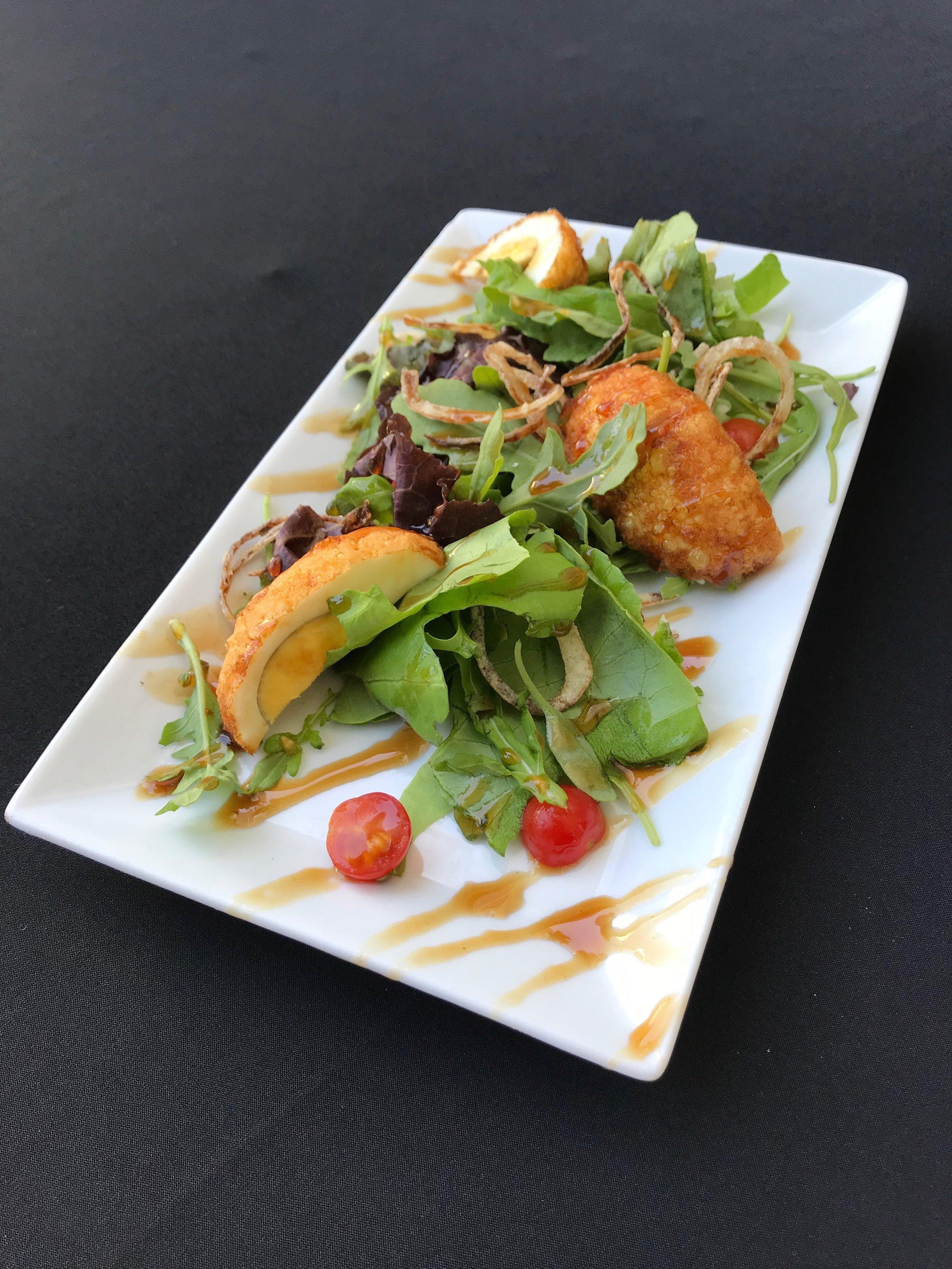 - Arugula & Tamarind Salad Arugula, mixed greens, fried shallots, and hardboiled egg, served with a tamarind & fish sauce vinaigrette