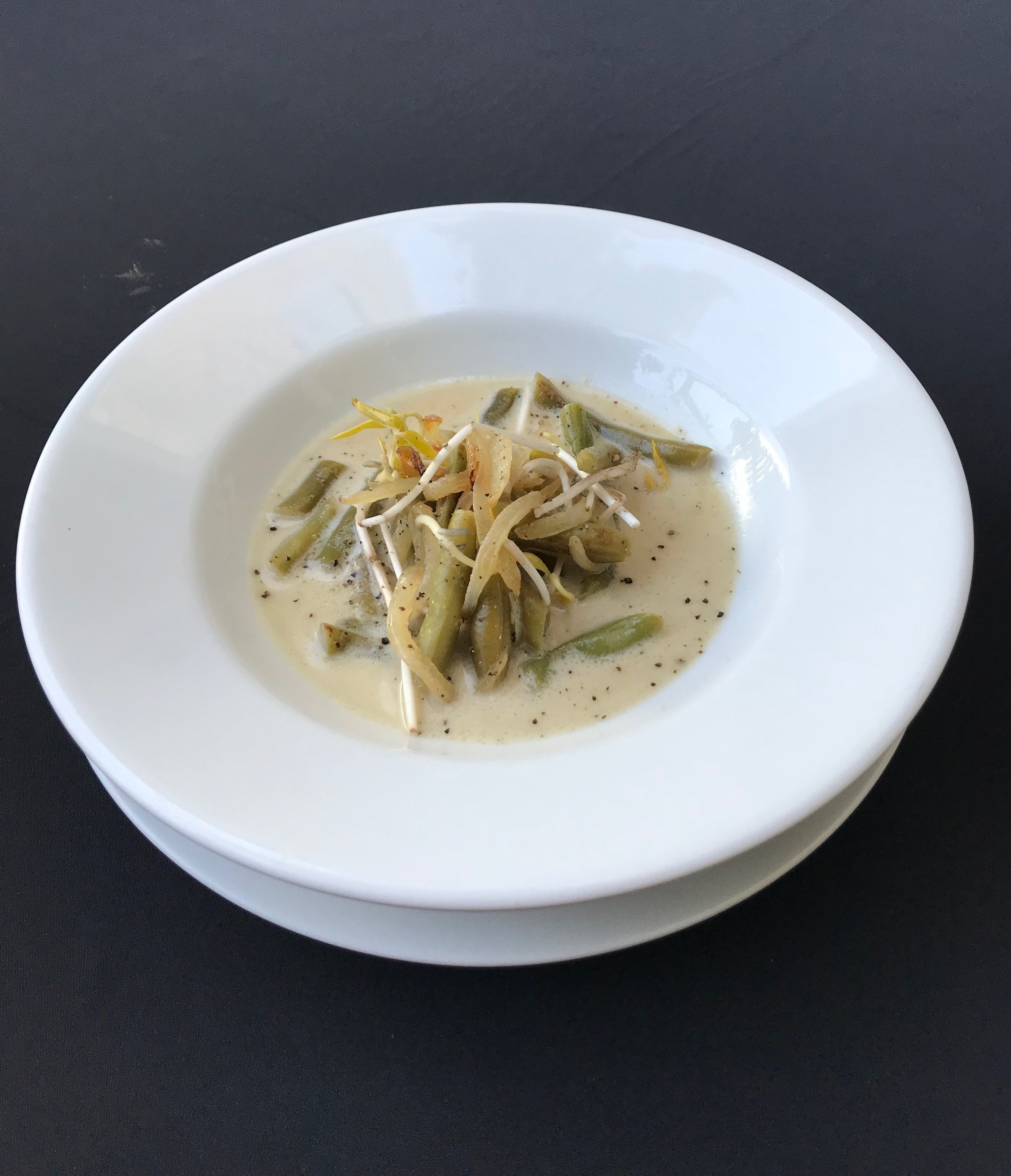- Almond, Green Bean & Coconut Soup Seasoned almonds, green beans, and coriander puree, infused in a creamy coconut milk, served with bean sprouts, and fried shallots
