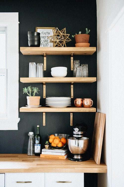 black kitchen with wooden shelves