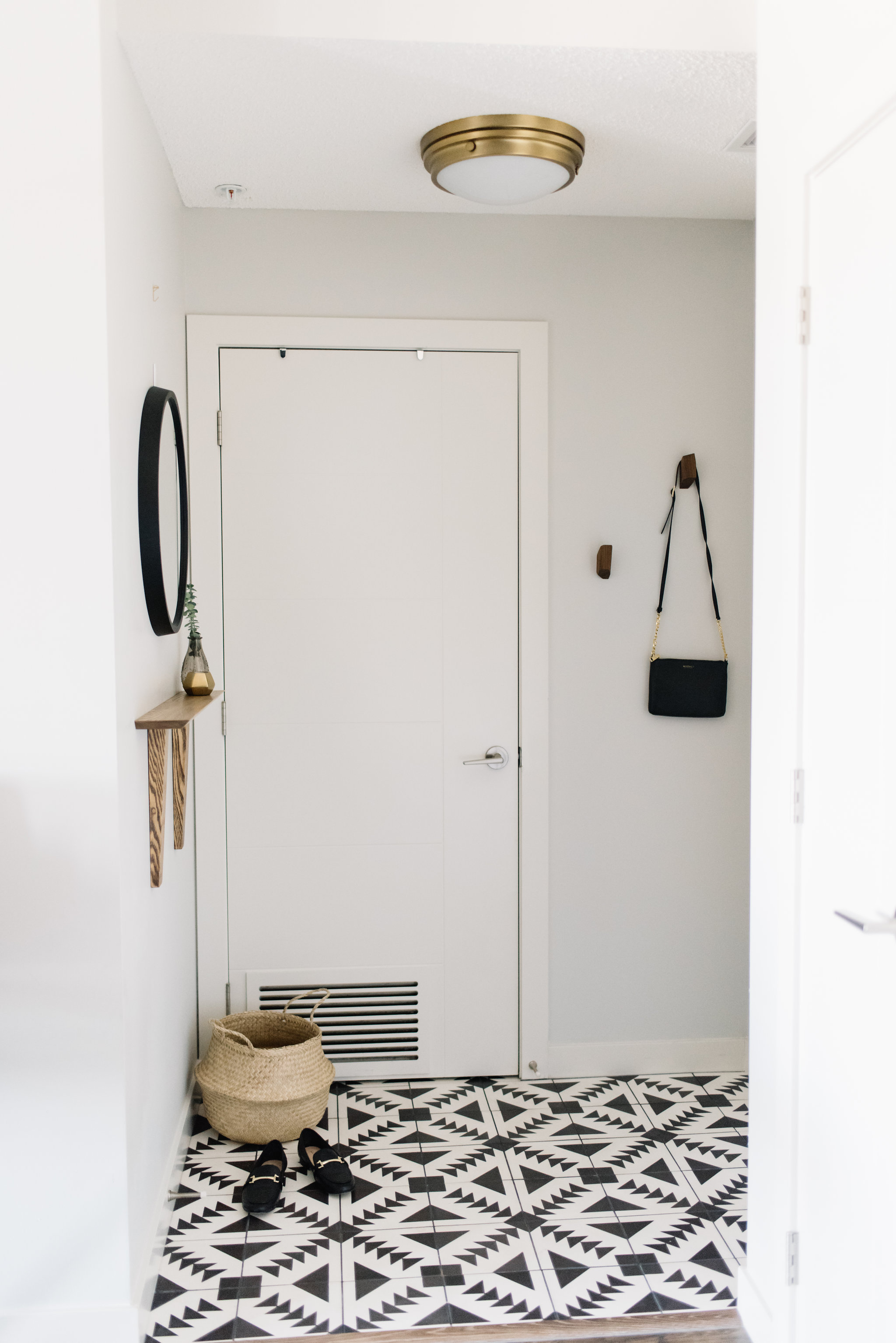 front entry with patterned tile floor
