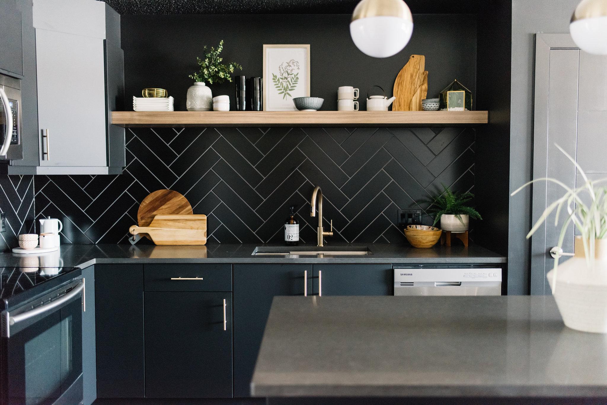 matte black kitchen with walnut shelf