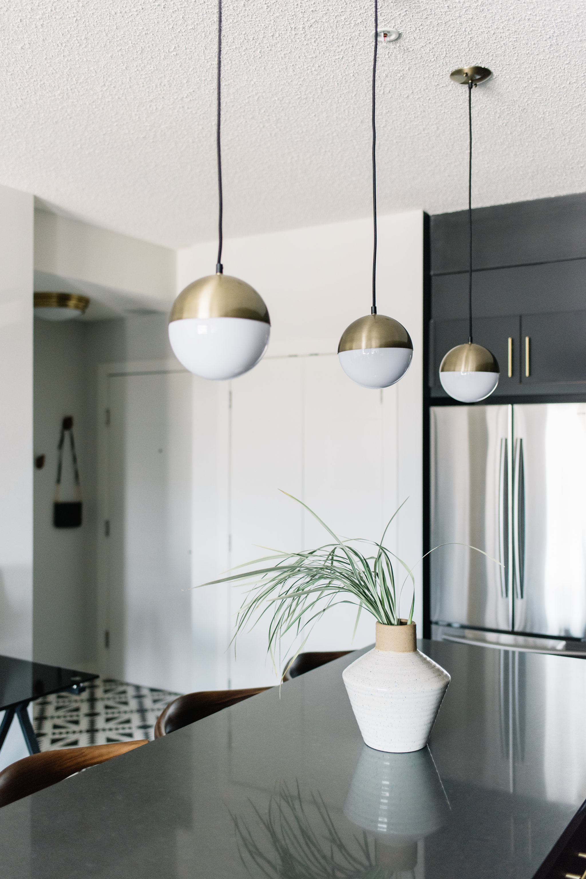 black kitchen with brass accents