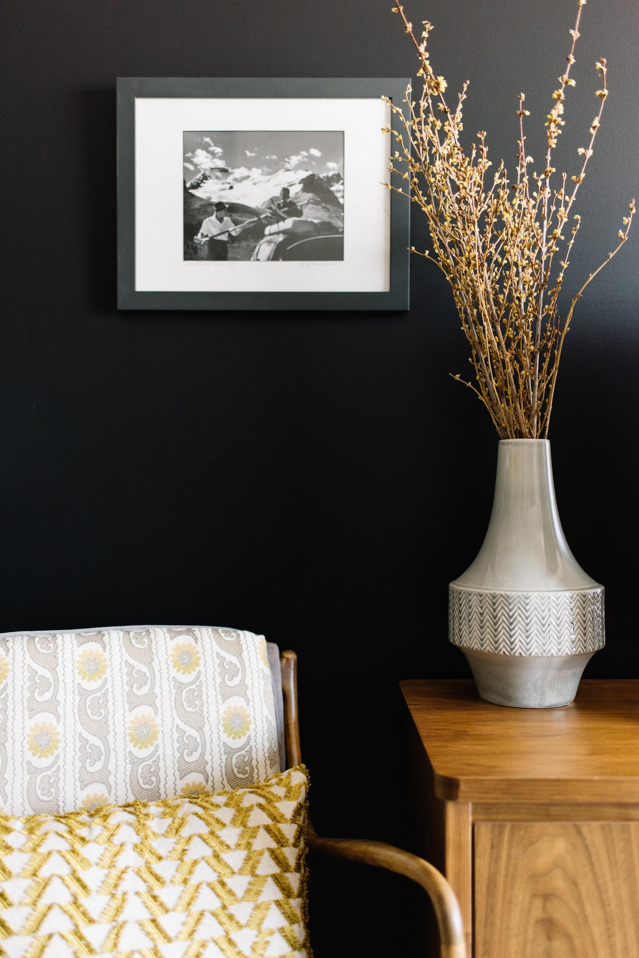 black wall, walnut furniture interior design