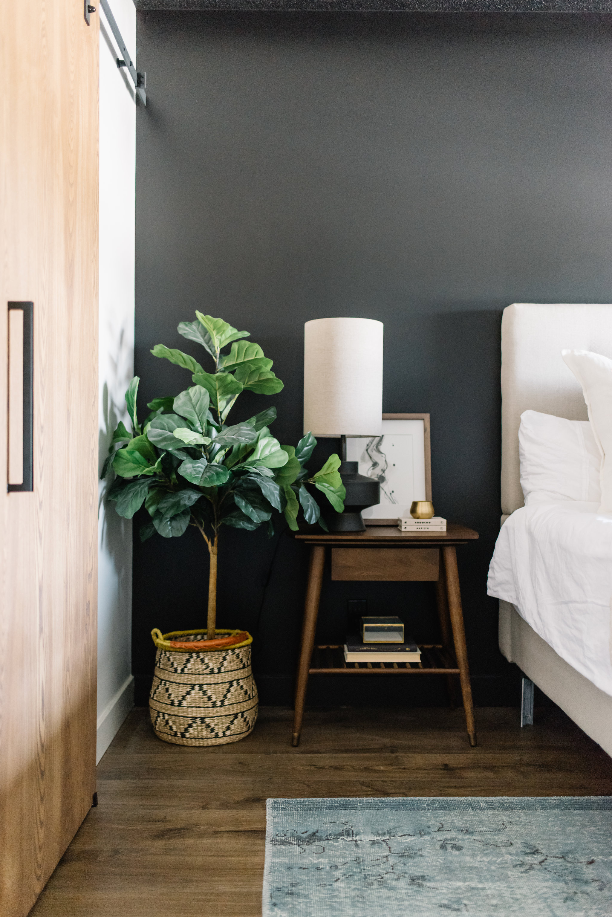 modern bedroom black wall and walnut side table