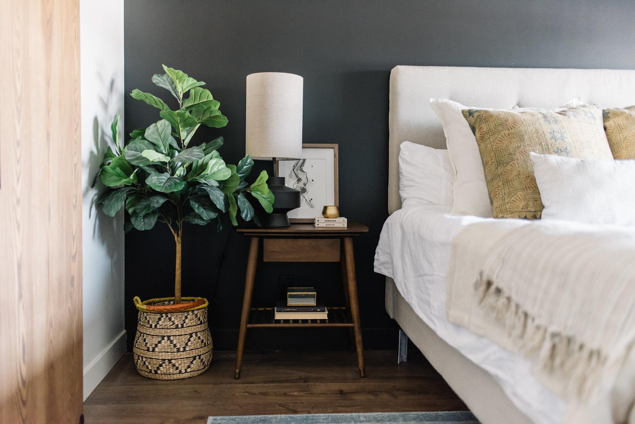 modern bedroom design, black wall and walnut bedside table