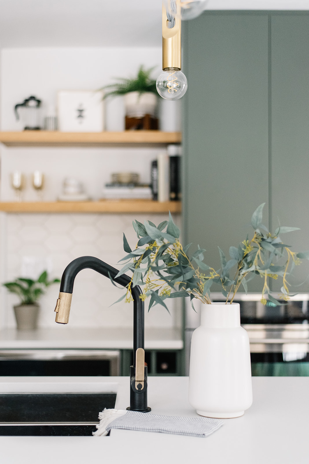 brizo black and brass faucet