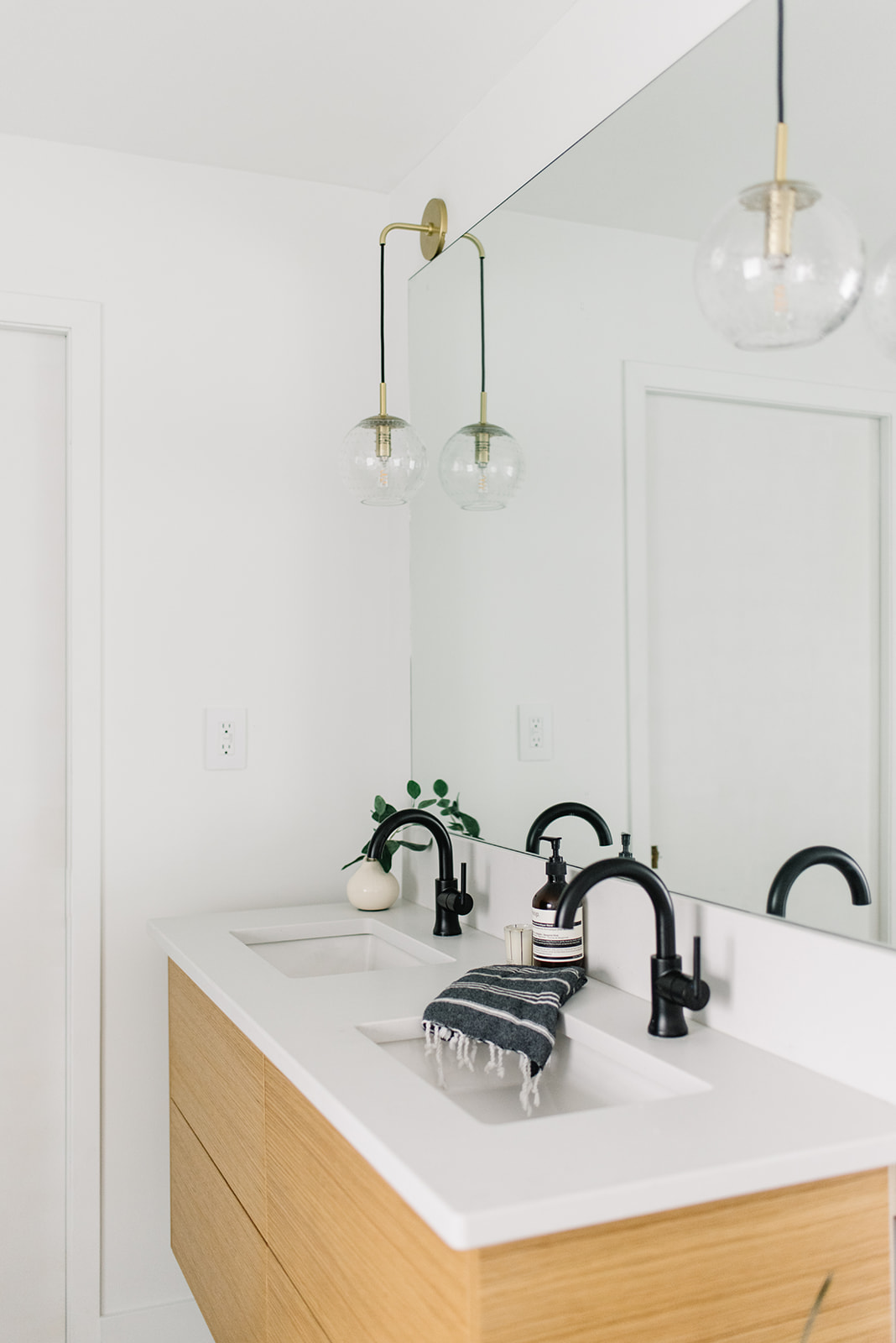 bathroom design oak vanity and black fixtures