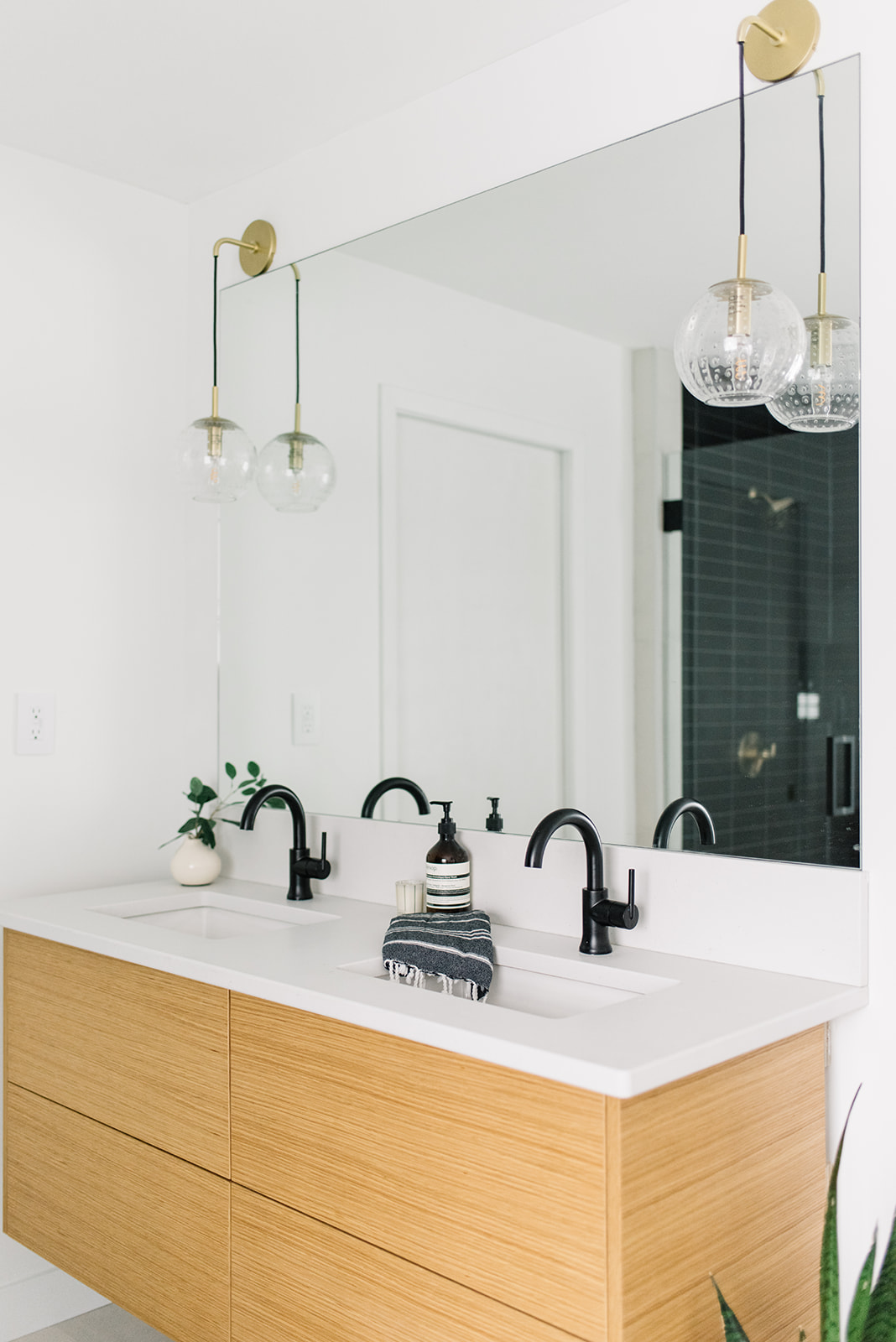 brass hanging pendants above bathroom vanity