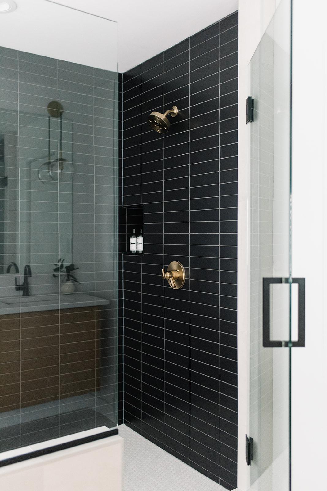 black subway tile in shower