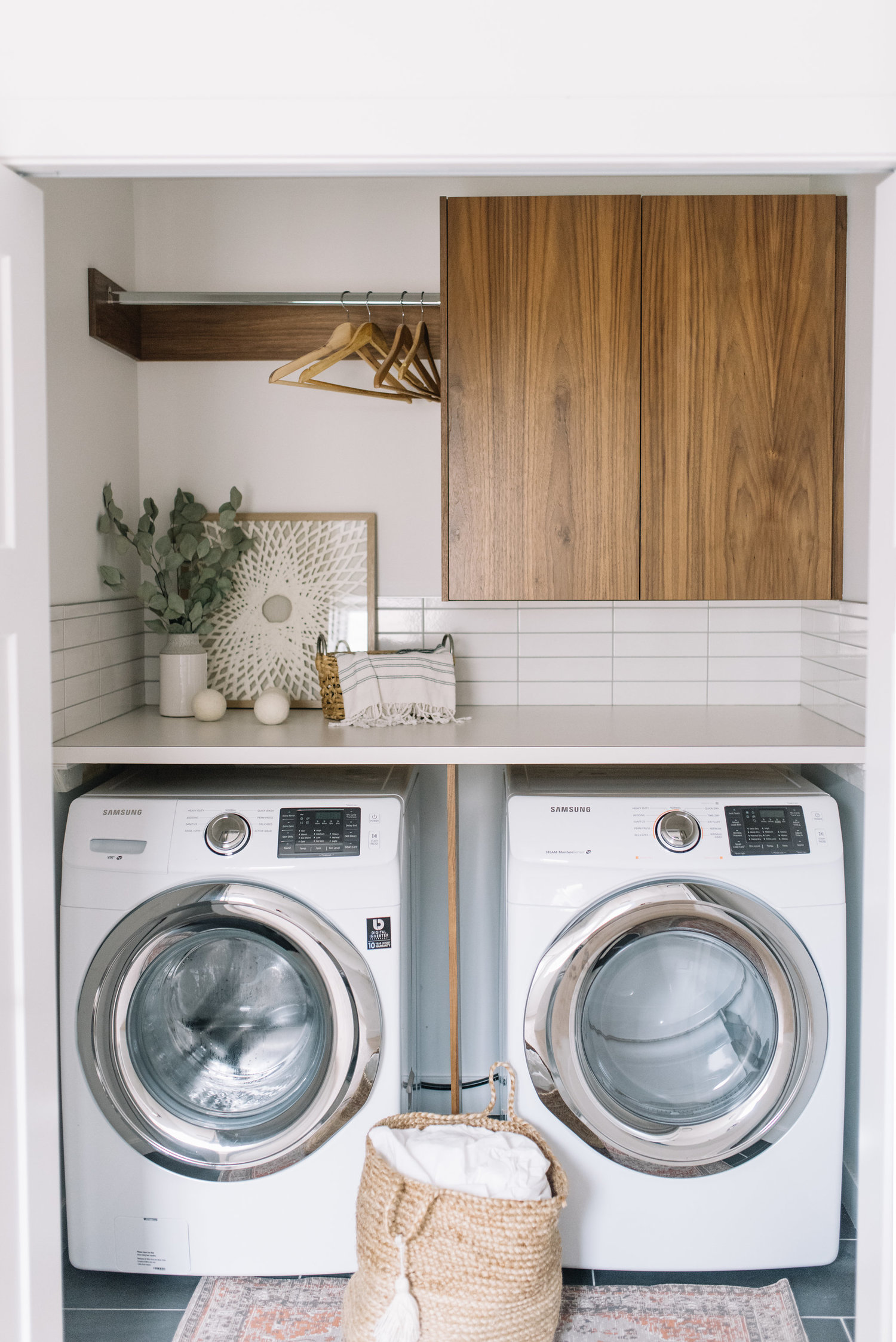 modern laundry room with walnut cabinetry
