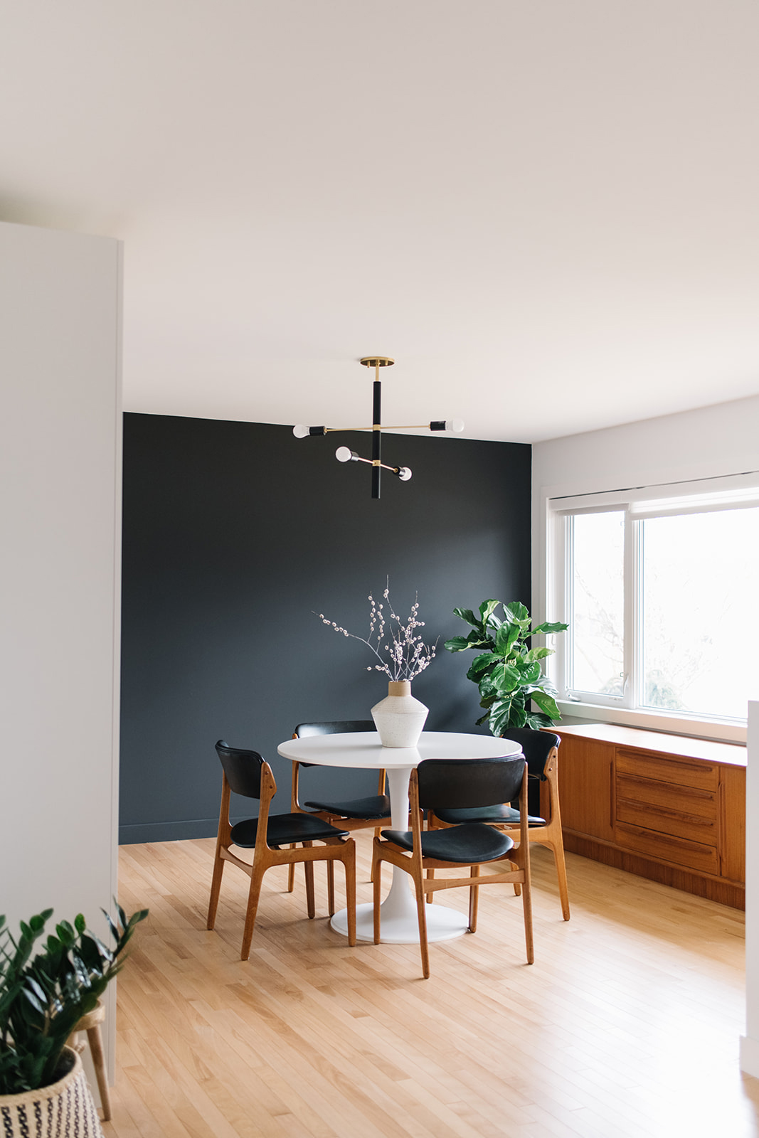 modern dining room with black wall