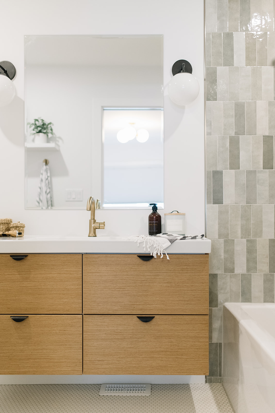 modern oak vanity with grey stacked subway tile