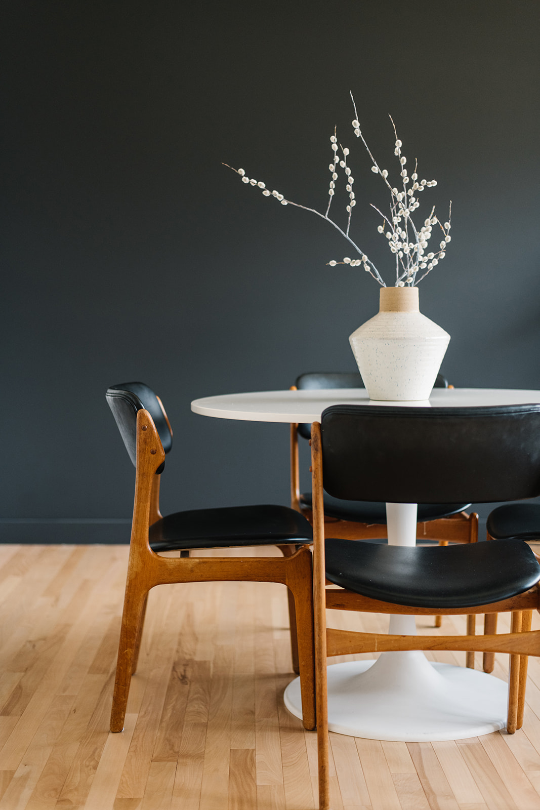 modern black dining room with vintage chairs