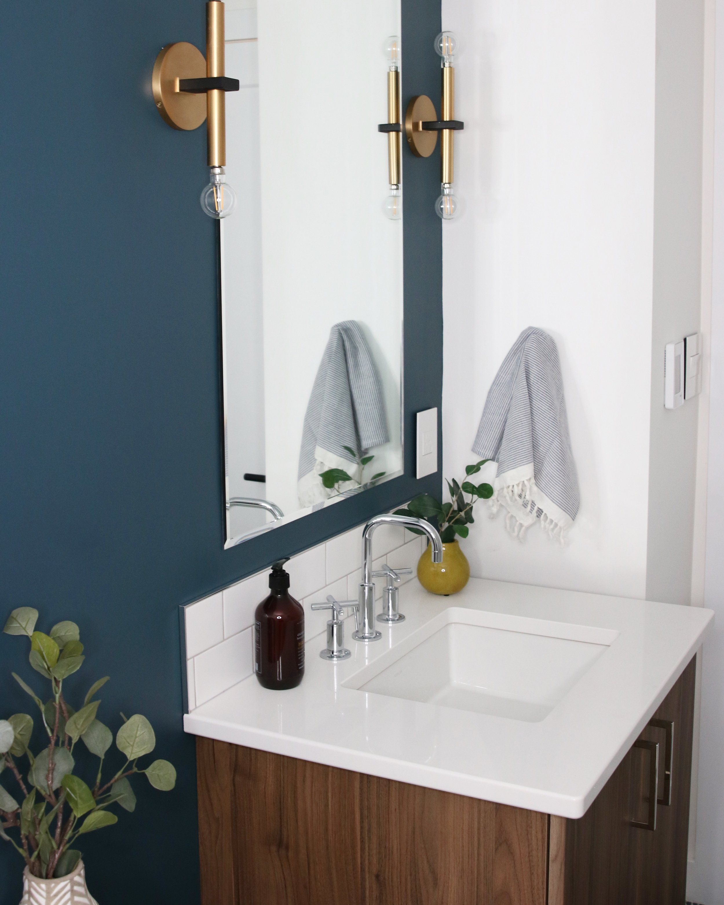 blue bathroom with walnut vanity