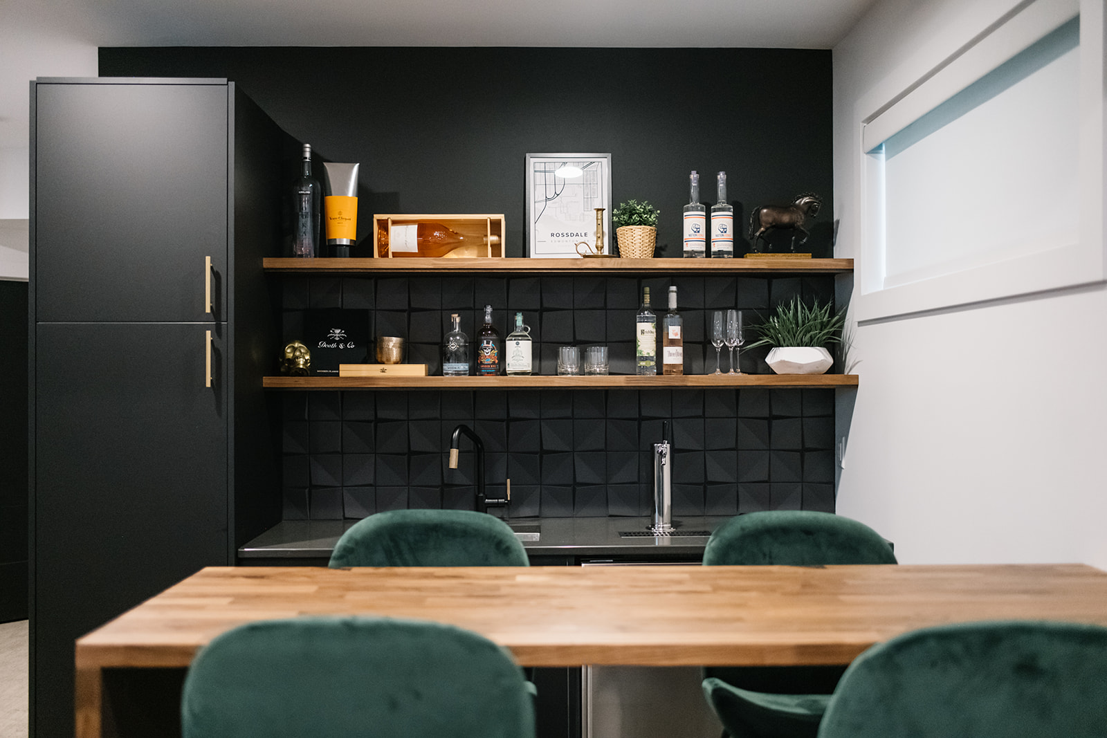 modern wet bar with black cabinets