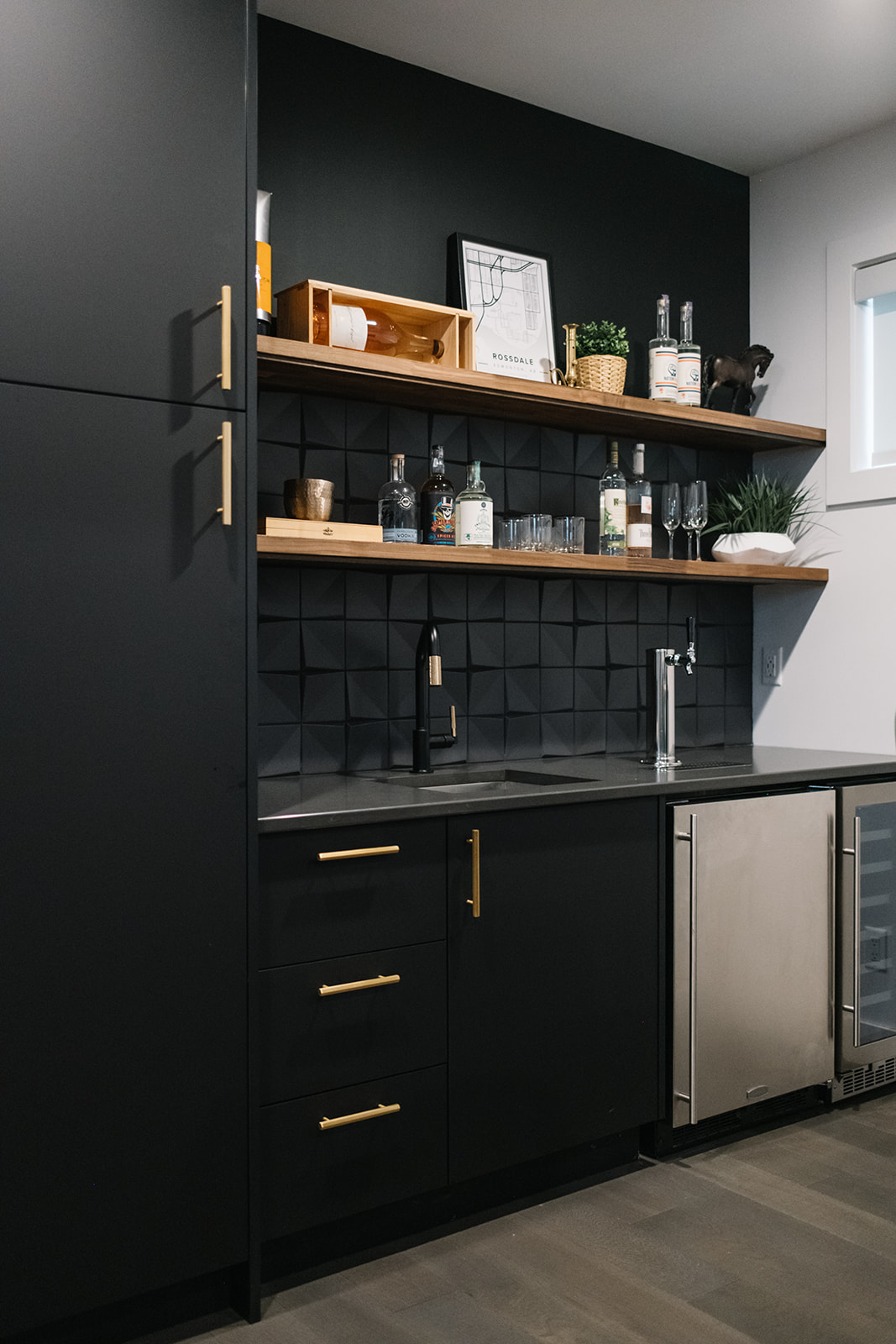matte black cabinets with with brass hardware
