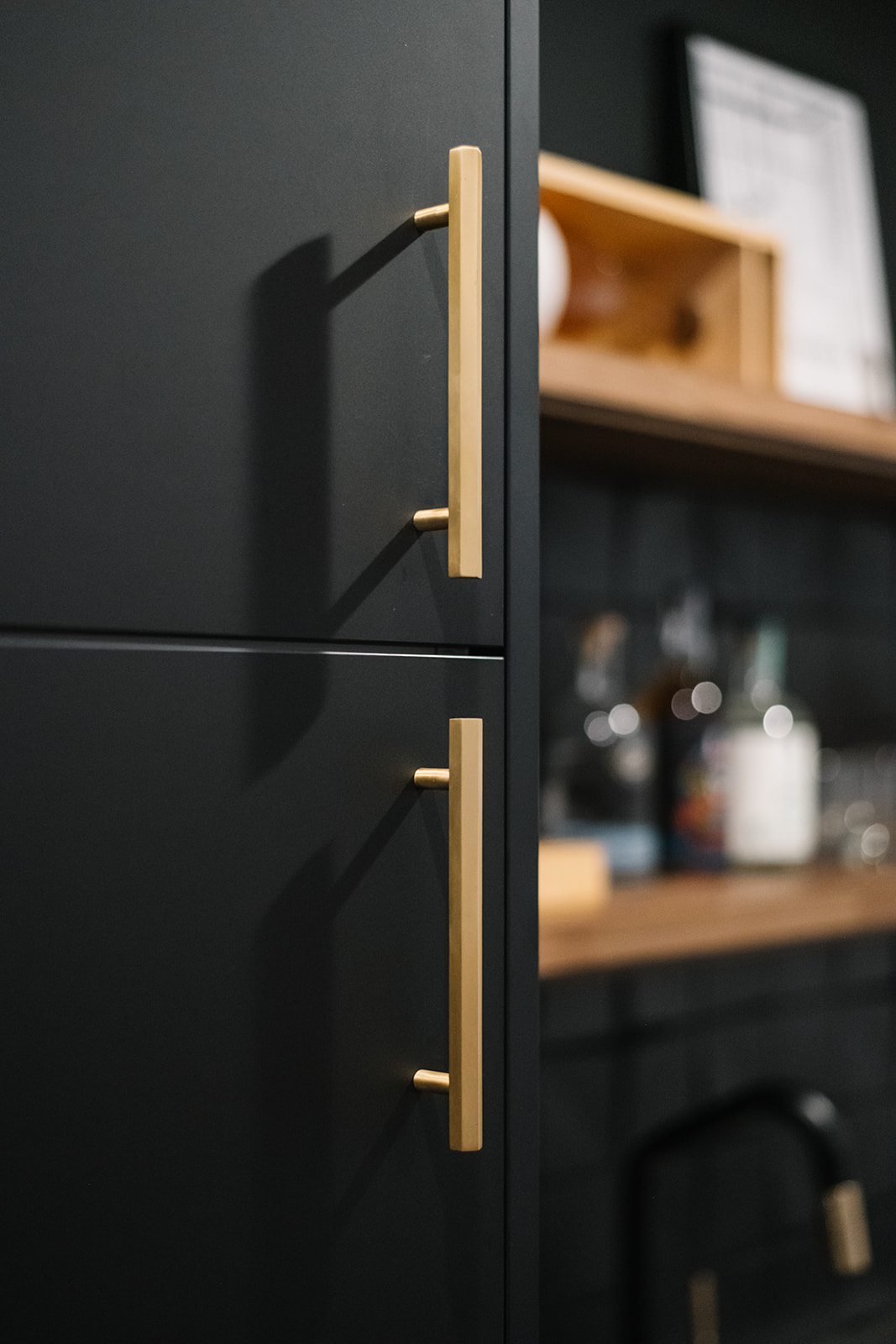 black cabinets with brass hardware