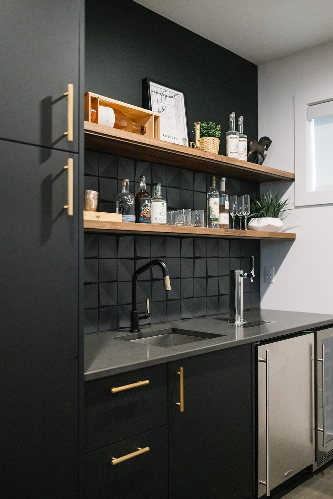 black cabinets with modern backsplash