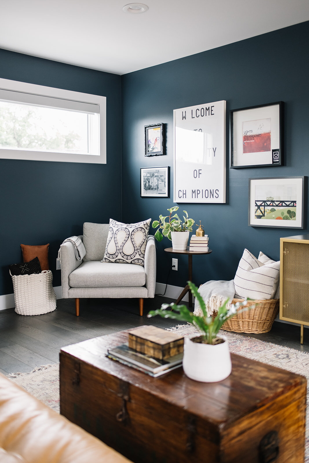 eclectic living room with blue wall
