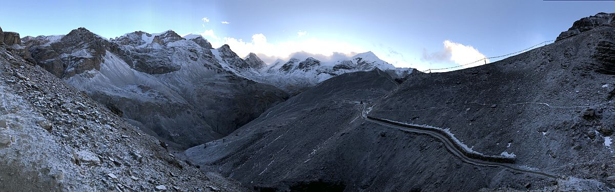 The trail from High Camp snakes up the valley to Thorung La, the high point on the Annapurna Circuit. Prayer flags can be seen on the ridge to the right as the sun rises.