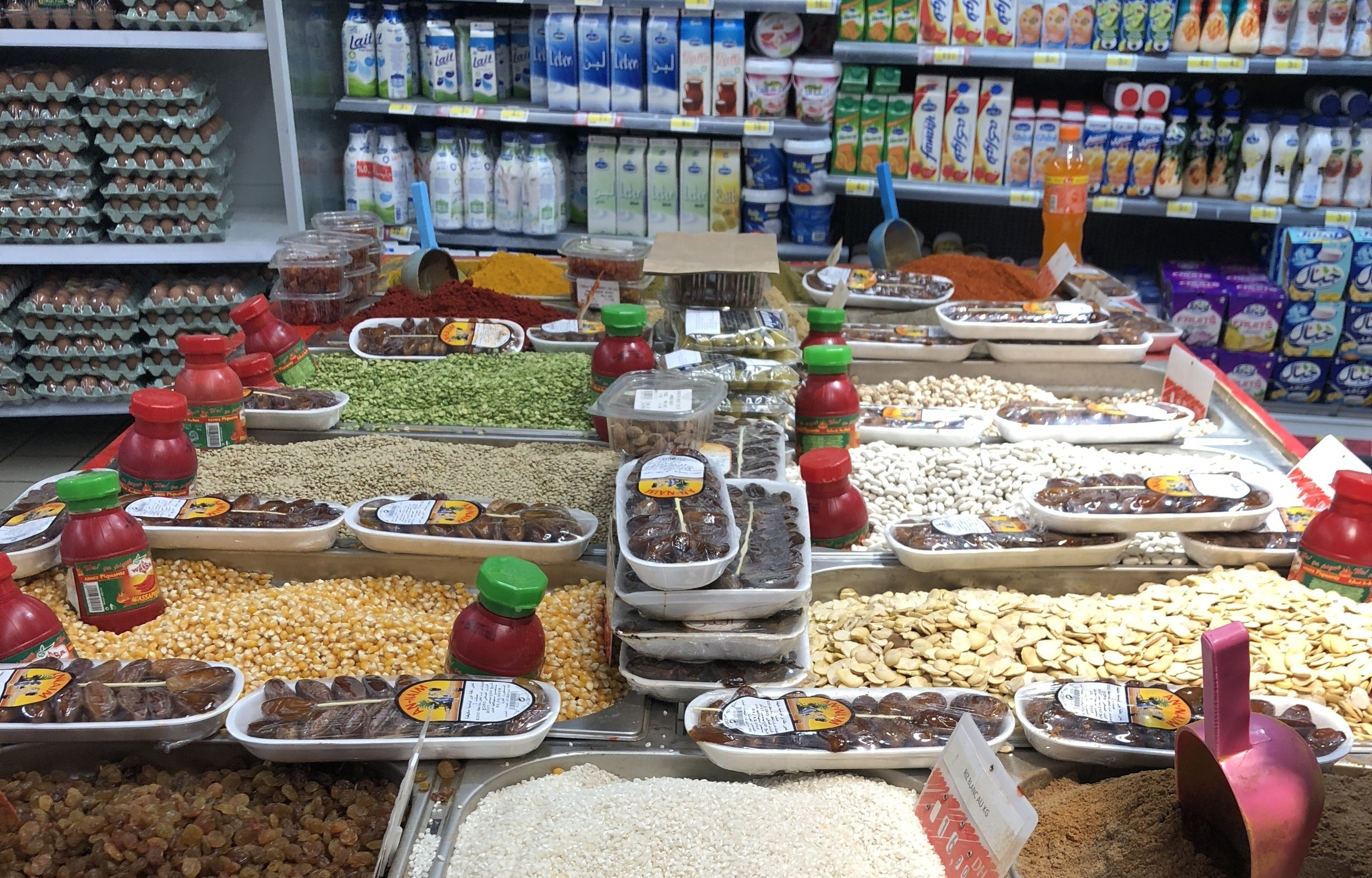 Dried fruits and grains, and in the background a refrigerated case of mystifying dairy products.