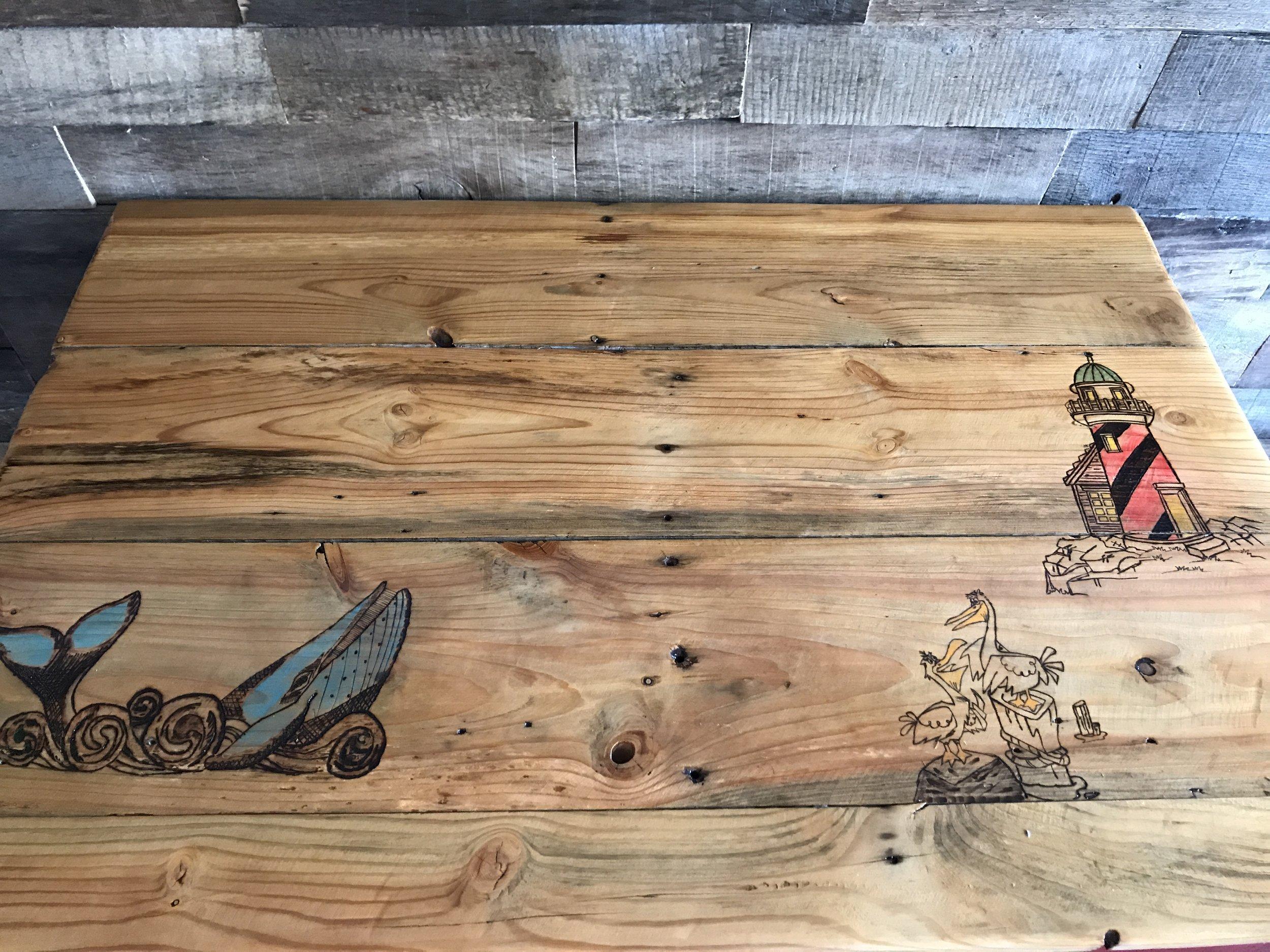 Wood burning on repurposed old barn-board countertop.