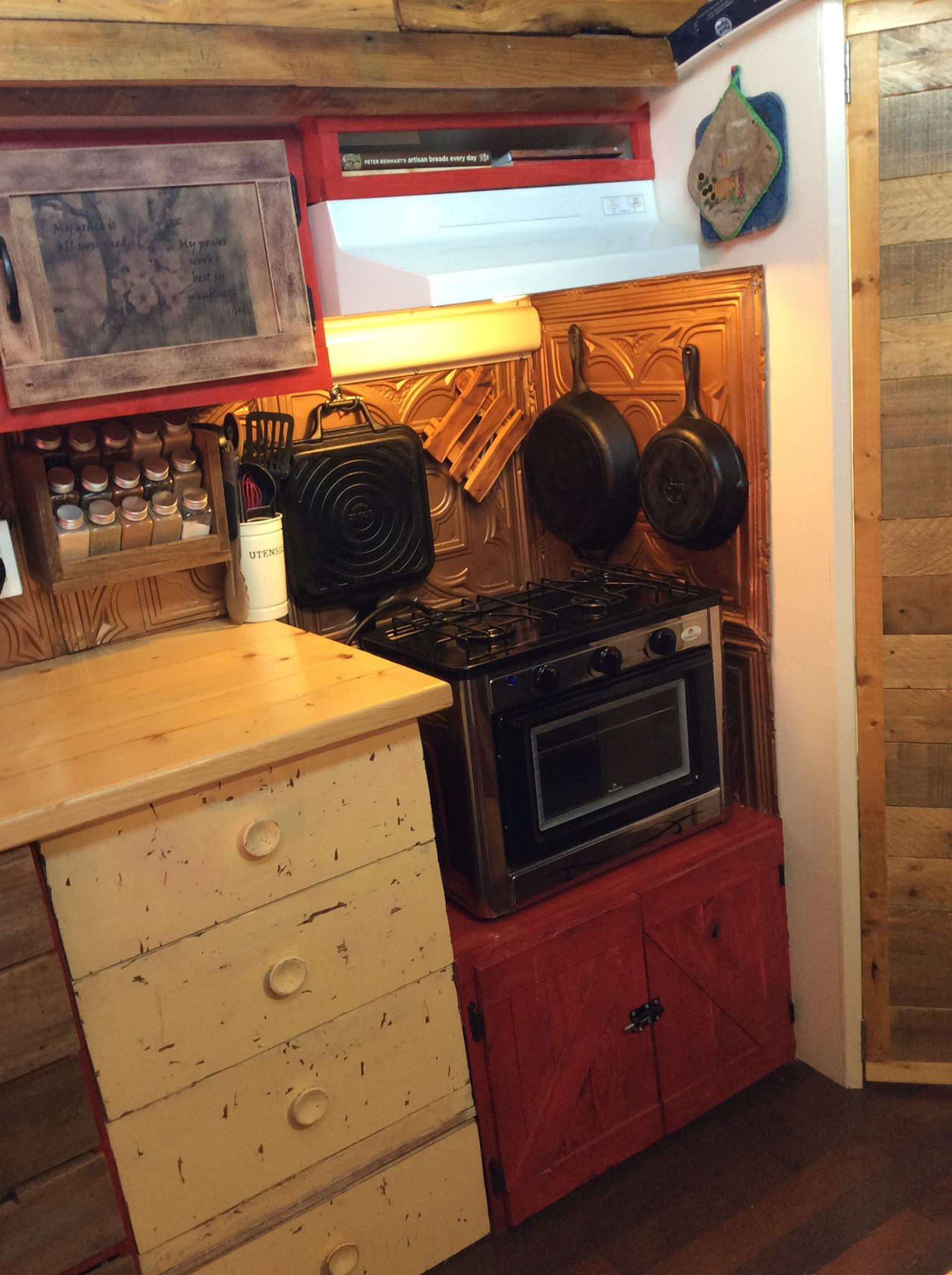 The kitchen nook! The backsplash is from old tin celling tiles and propane stove and oven we picked up from Home Hardware. Almost everything in our bus is repurposed and reused!