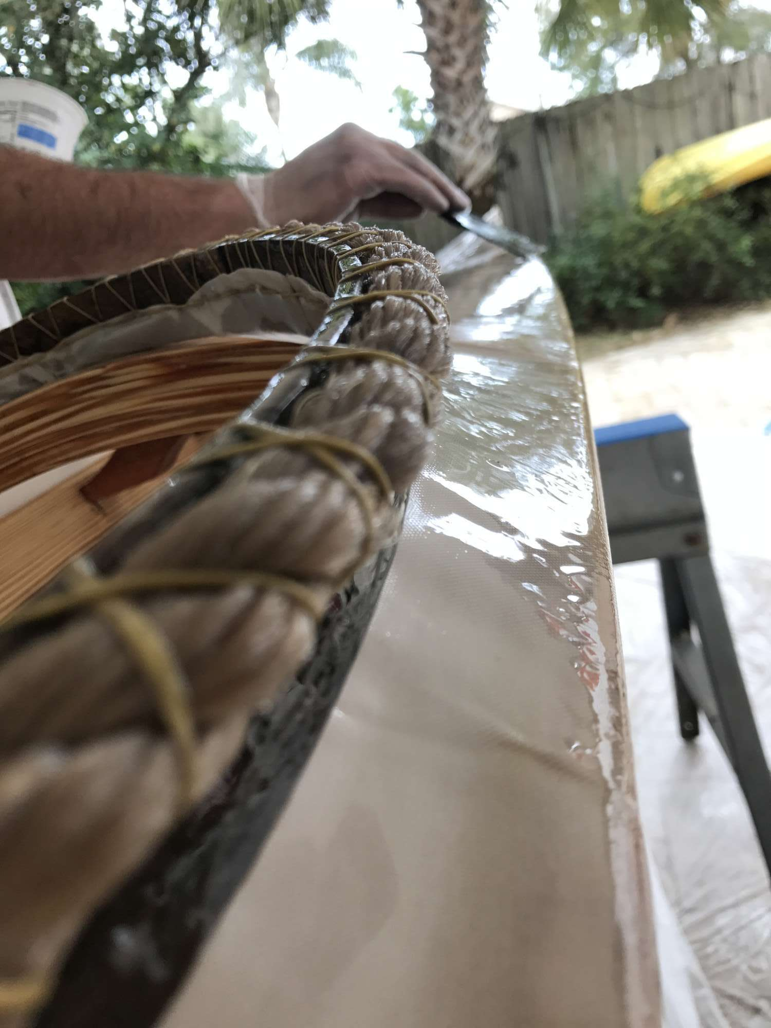 It is very sticky when wet, but dries as a slightly flexible (not rock hard like epoxy) finish.