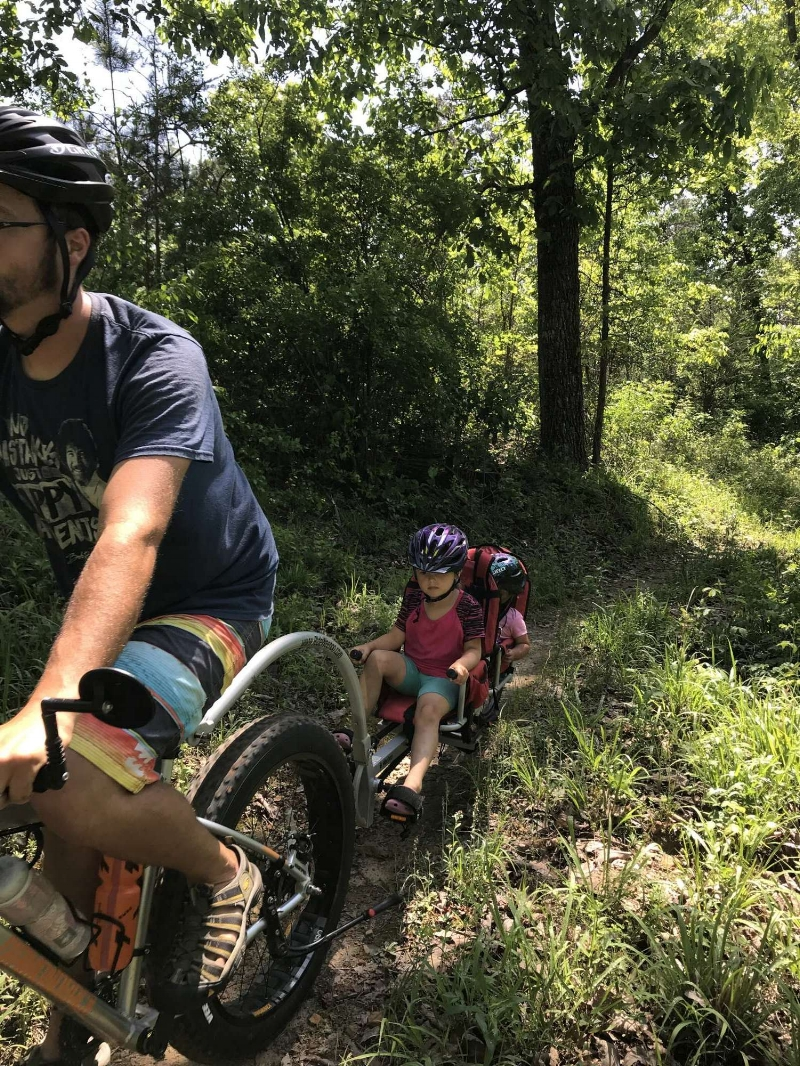 Trail riding with the family is challenging, fun, and preferable to highway riding!