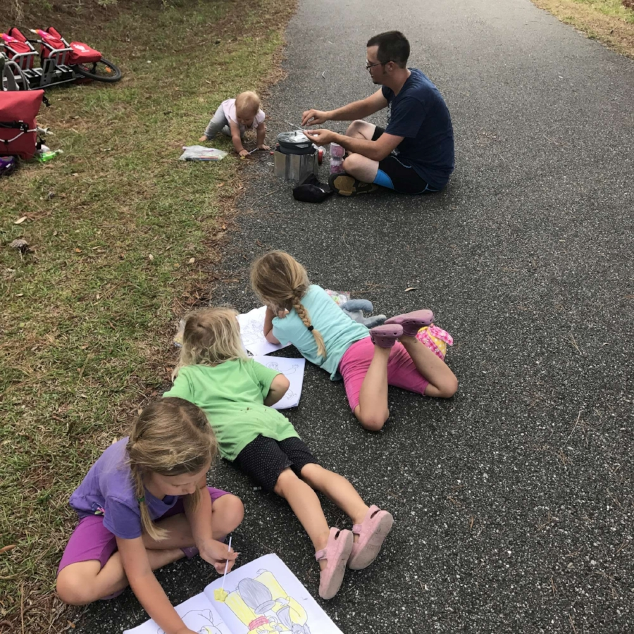 Making lunch and enjoying a rest (and colouring) break on the side of a bike path.