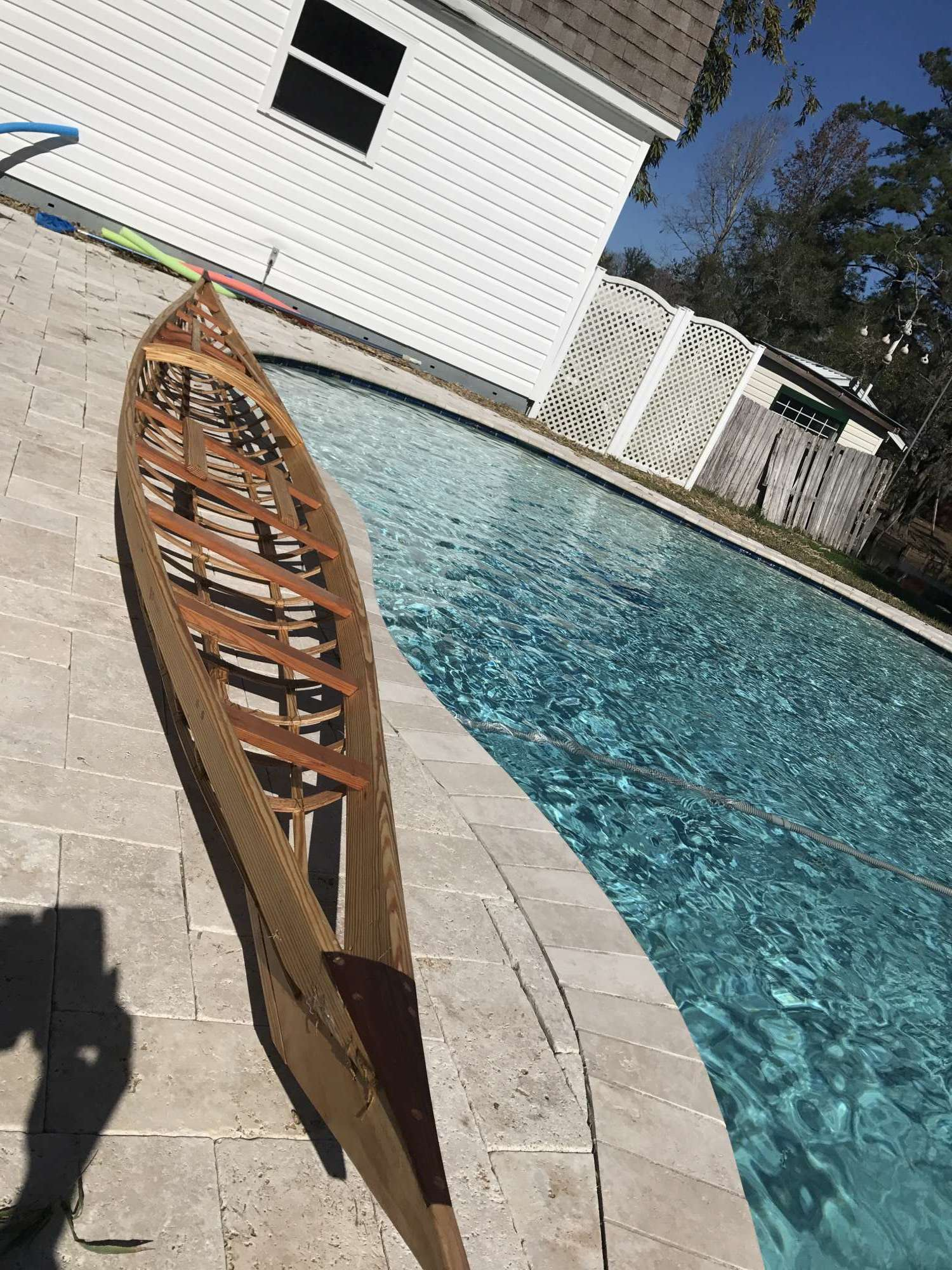Not quite ready to be put in the water, but it is coated in tung oil (it absorbs into the wood) and the kayak is ready to be covered with fabric!