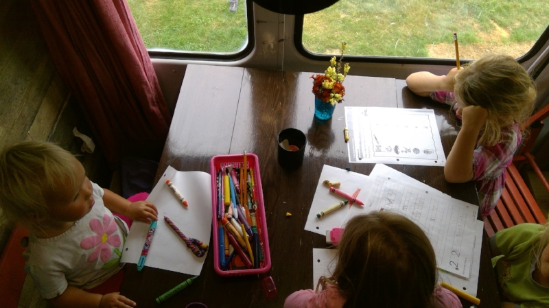 School for our family happens at the table, outside or even on the couch.