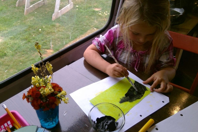"""Black paint over yellow crayon creates a """"scratch and see"""" picture of the night sky!"""