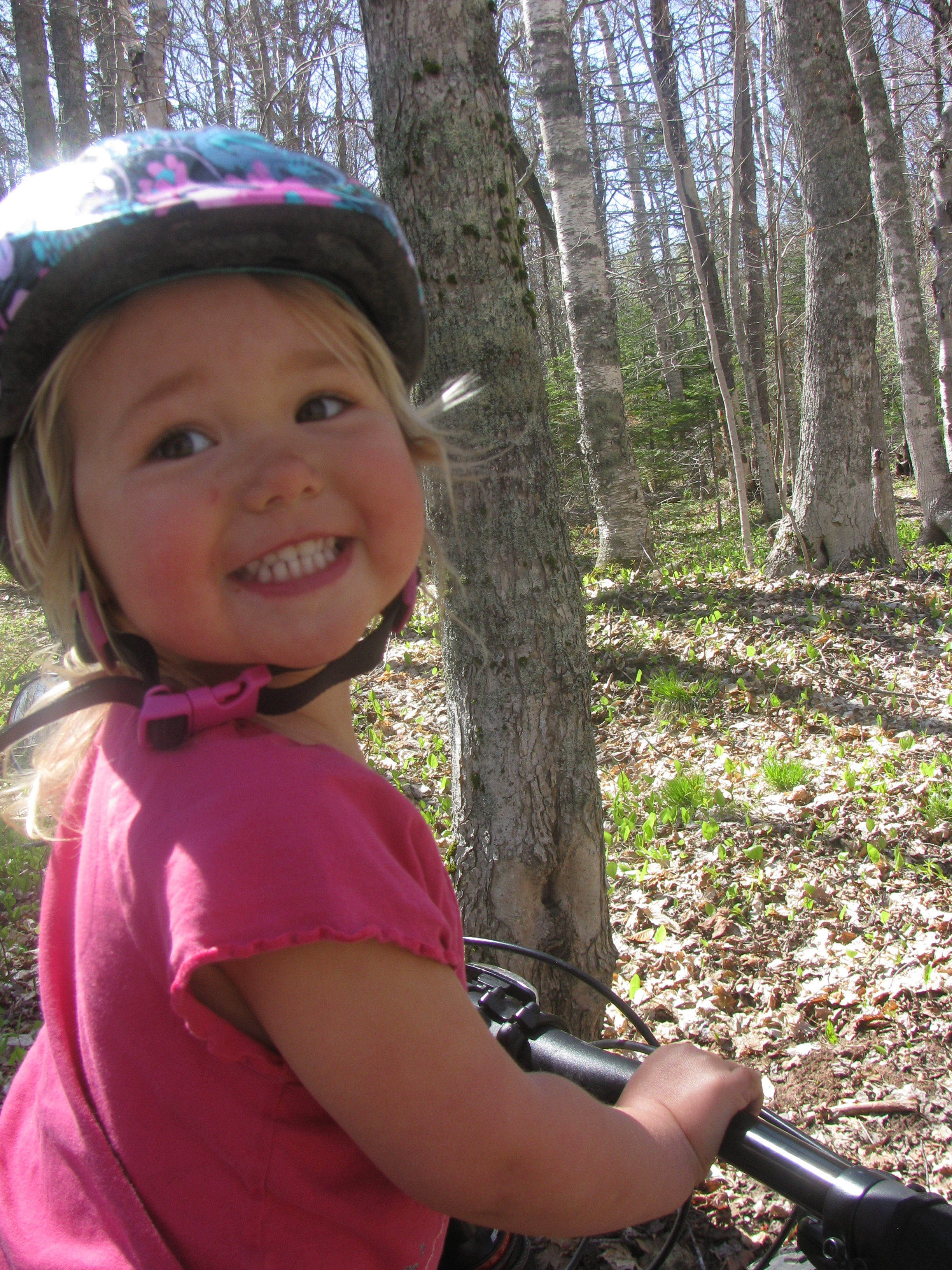 Riding the trails with mommy brings lots of smiles!